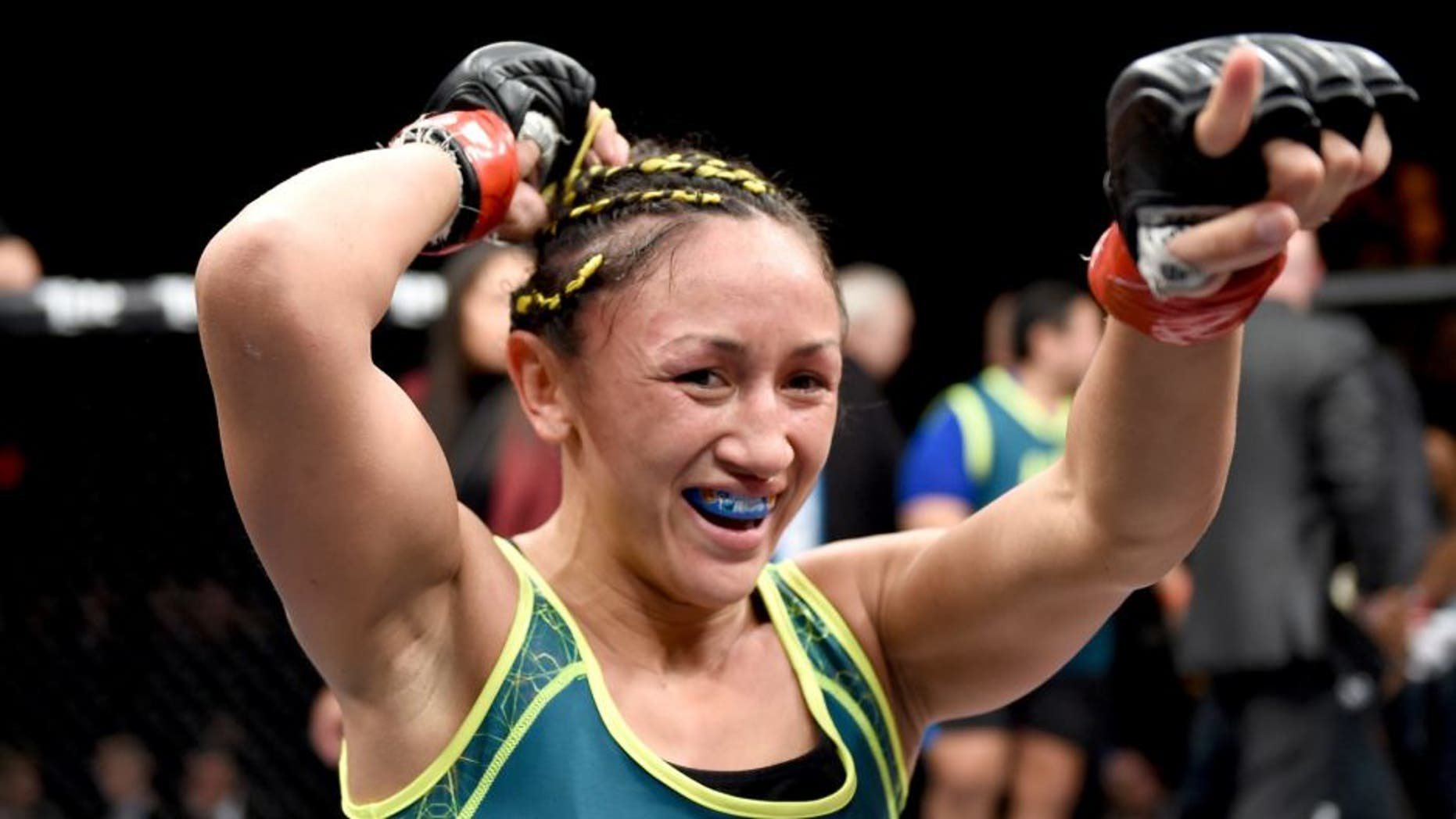 LAS VEGAS, NEVADA - DECEMBER 12: Carla Esparza celebrates her submission victory over Rose Namajunas in their strawweight championship fight during The Ultimate Fighter Finale event inside the Pearl concert theater at the Palms Casino Resort on December 12, 2014 in Las Vegas, Nevada. (Photo by Jeff Bottari/Zuffa LLC/Zuffa LLC via Getty Images)