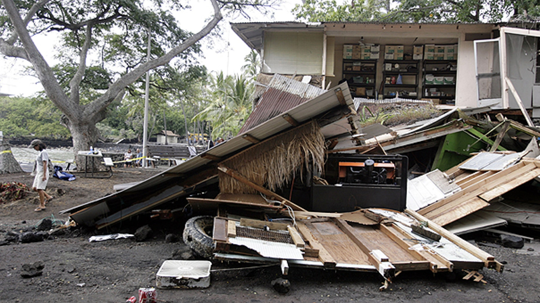 March 11: The partially collapsed Sea Quest Rafting Adventures building following a tsunami wave that struck Keauhou Bay, on the island of Hawaii.