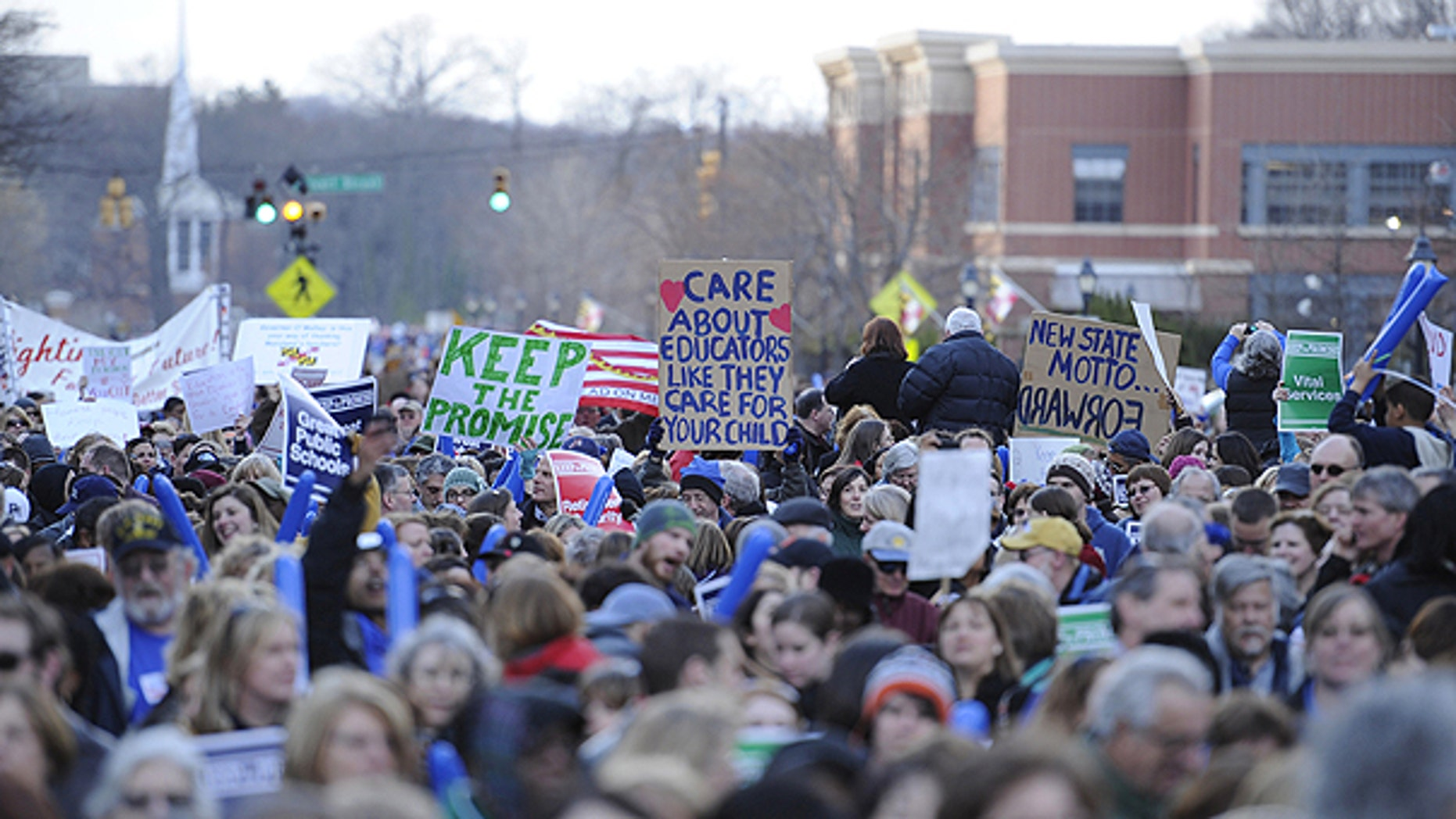 March 14: Protesters hold up signs at the Keep the Promise rally, a rally to protest pension reform in Annapolis, Md.