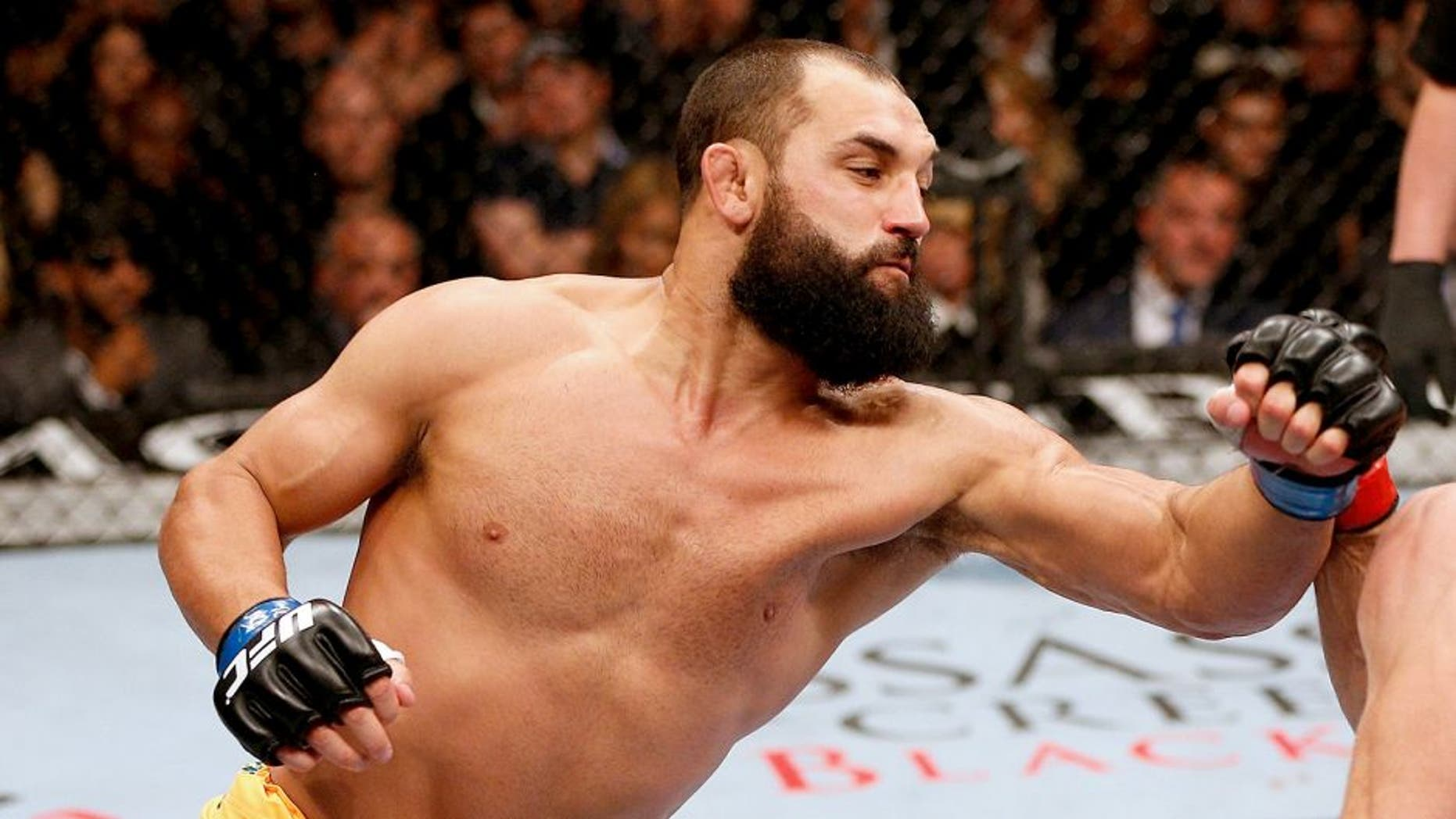 LAS VEGAS, NV - NOVEMBER 16: (L-R) Johny Hendricks punches Georges St-Pierre in their UFC welterweight championship bout during the UFC 167 event inside the MGM Grand Garden Arena on November 16, 2013 in Las Vegas, Nevada. (Photo by Josh Hedges/Zuffa LLC/Zuffa LLC via Getty Images)