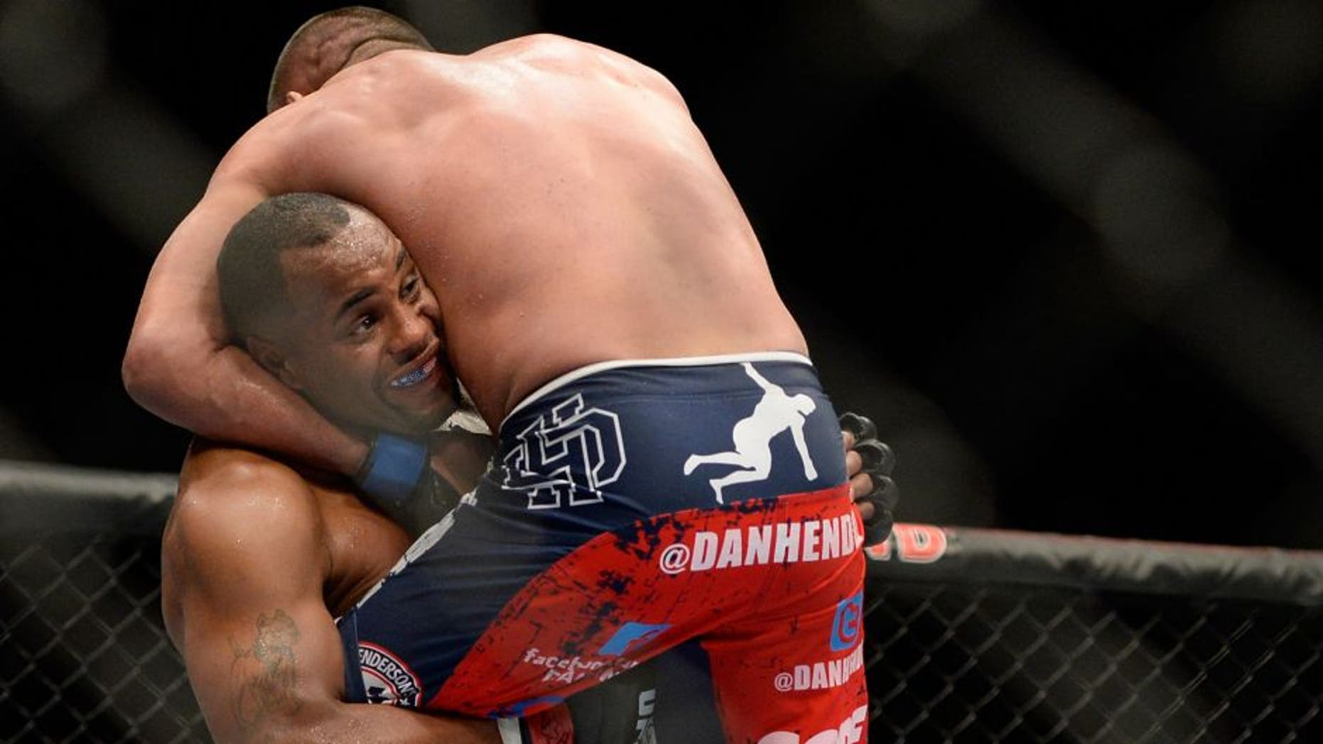 LAS VEGAS, NV - MAY 24: (L-R) Daniel Cormier throws down Dan Henderson in their light heavyweight bout during the UFC 173 event at the MGM Grand Garden Arena on May 24, 2014 in Las Vegas, Nevada. (Photo by Jeff Bottari/Zuffa LLC/Zuffa LLC via Getty Images)