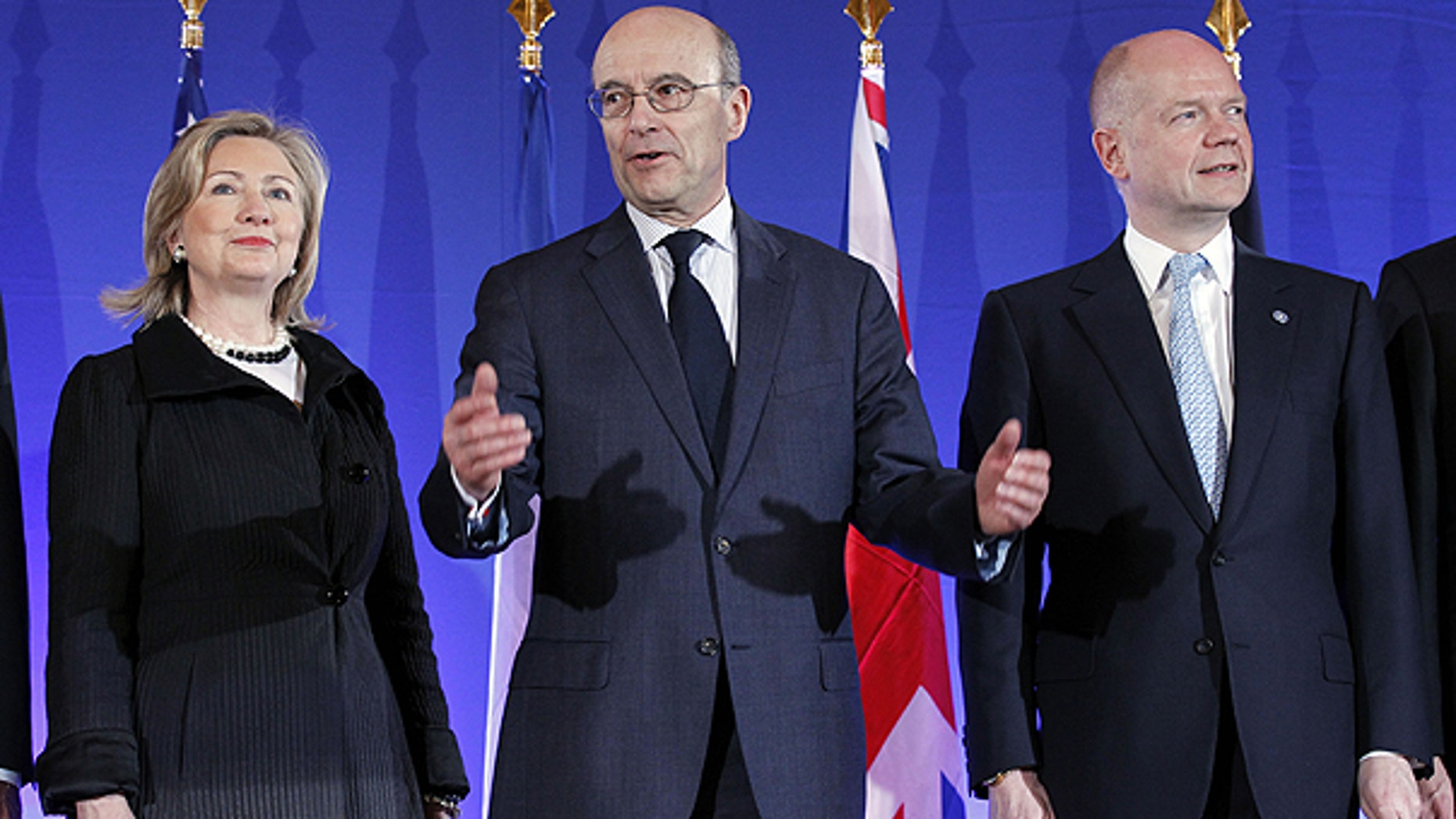 March 14: French Foreign Minister Alain Juppe, center, gestures as he poses with his counterpart William Hague of Britain and U.S. Secretary of State Hillary Rodham Clinton, during a Group of Eight foreign Ministers meeting in Paris.