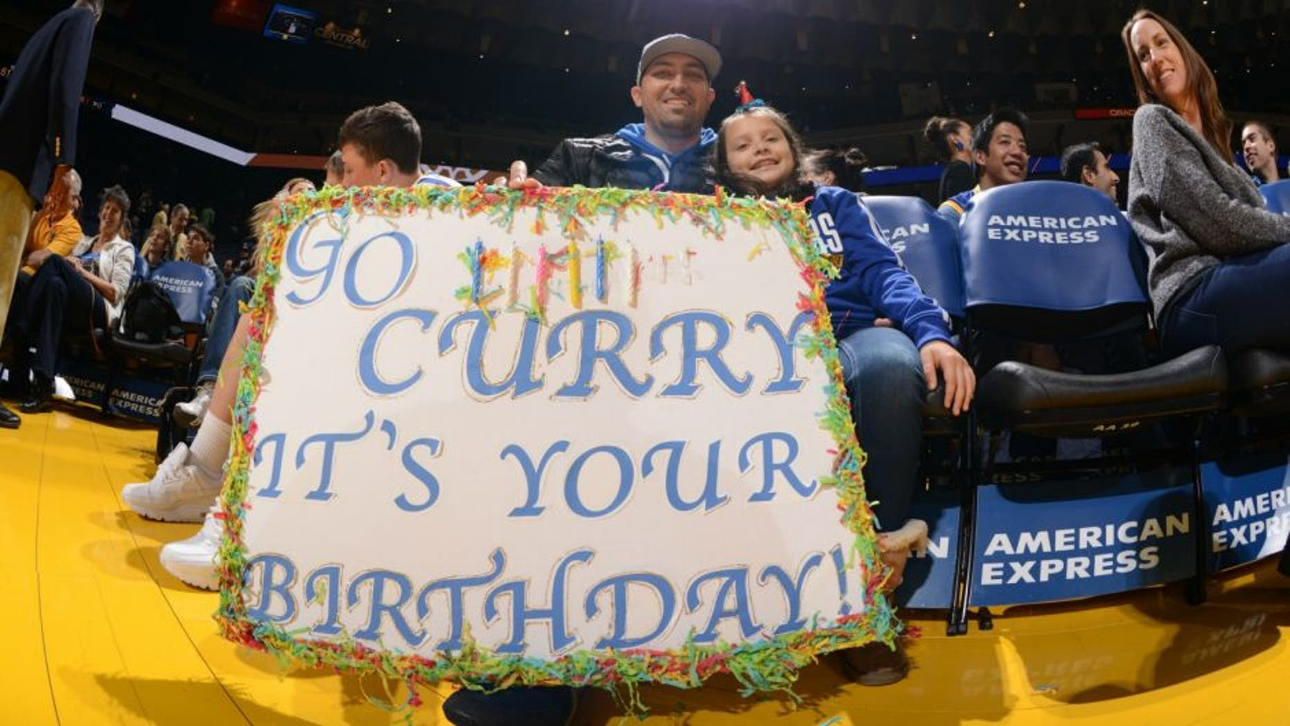 OAKLAND, CA - MARCH 14: Some fans hold up a happy birthday sign for Stephen Curry #30 of the Golden State Warriors on March 14, 2016 at Oracle Arena in Oakland, California. NOTE TO USER: User expressly acknowledges and agrees that, by downloading and or using this photograph, user is consenting to the terms and conditions of Getty Images License Agreement. Mandatory Copyright Notice: Copyright 2016 NBAE (Photo by Noah Graham/NBAE via Getty Images)
