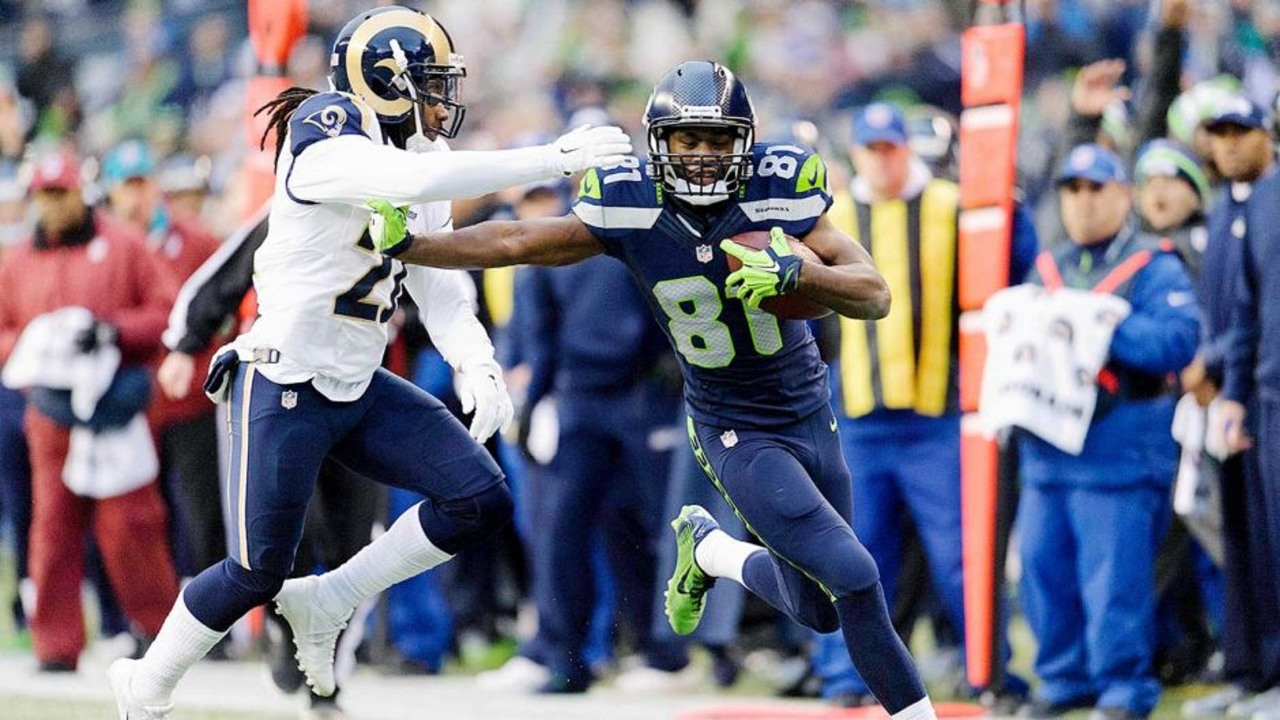 Dec 28, 2014; Seattle, WA, USA; Seattle Seahawks wide receiver Kevin Norwood (81) stiff arms St. Louis Rams cornerback Janoris Jenkins (21) during the second half at CenturyLink Field. Seattle defeated St. Louis 20-6. Mandatory Credit: Steven Bisig-USA TODAY Sports