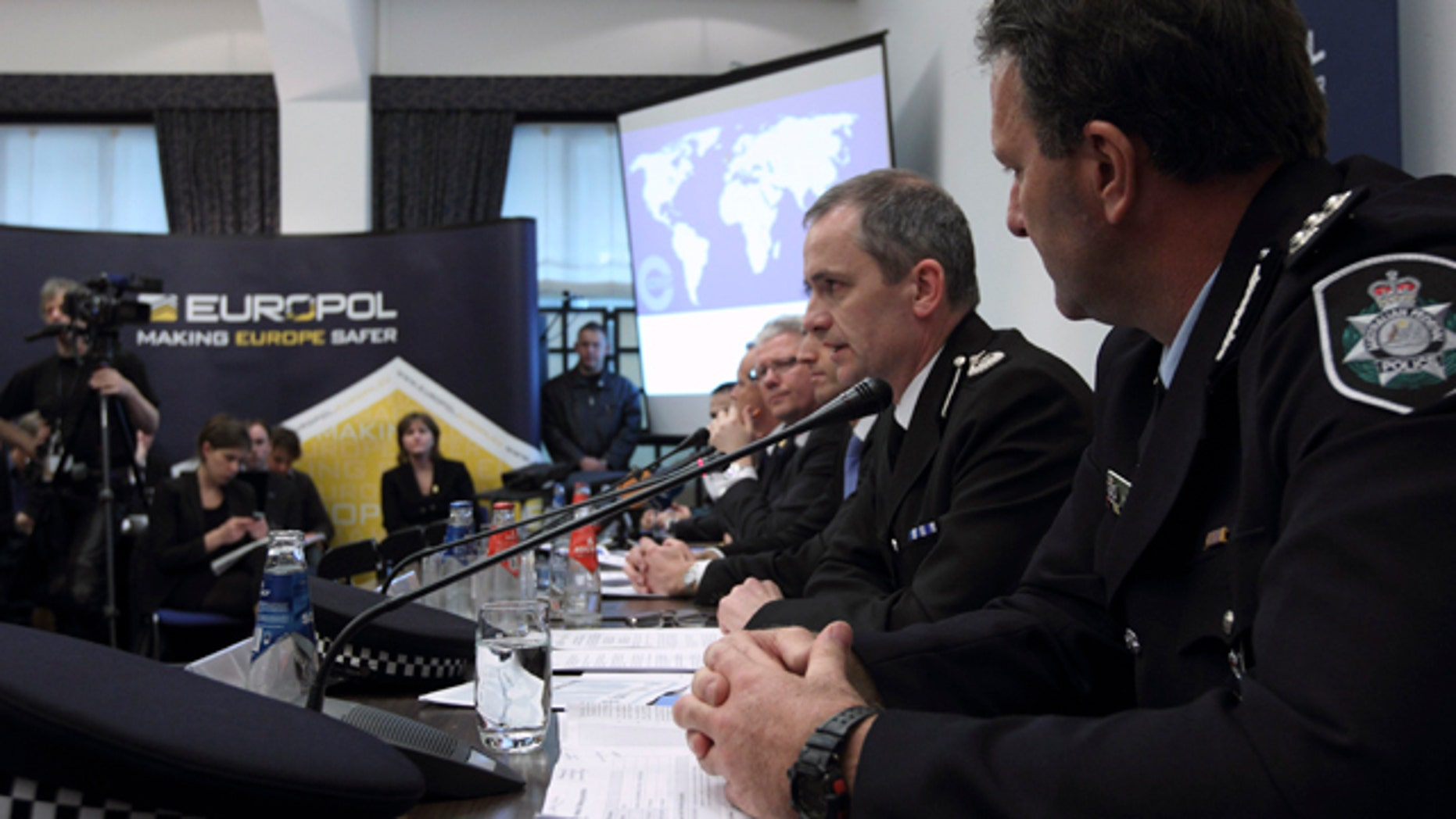 March 16: From left, Grant Edwards, Australian Federal Police, and Peter Davies, of the UK Child Exploitation and Online Protection Center, elaborate on the details of arrests linked to a global child abuse ring during a press conference in The Hague.
