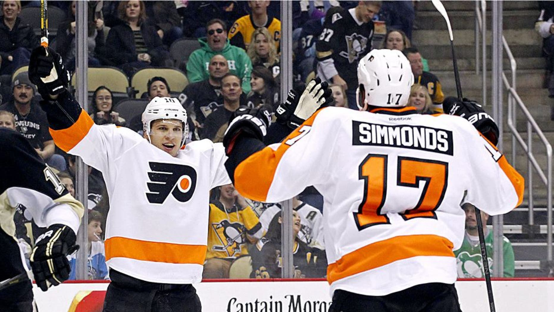 Mar 16, 2014; Pittsburgh, PA, USA; Philadelphia Flyers center Brayden Schenn (left) celebrates with right wing Wayne Simmonds (17) after Schenn scored a goal against the Pittsburgh Penguins during the first period at the CONSOL Energy Center. Mandatory Credit: Charles LeClaire-USA TODAY Sports