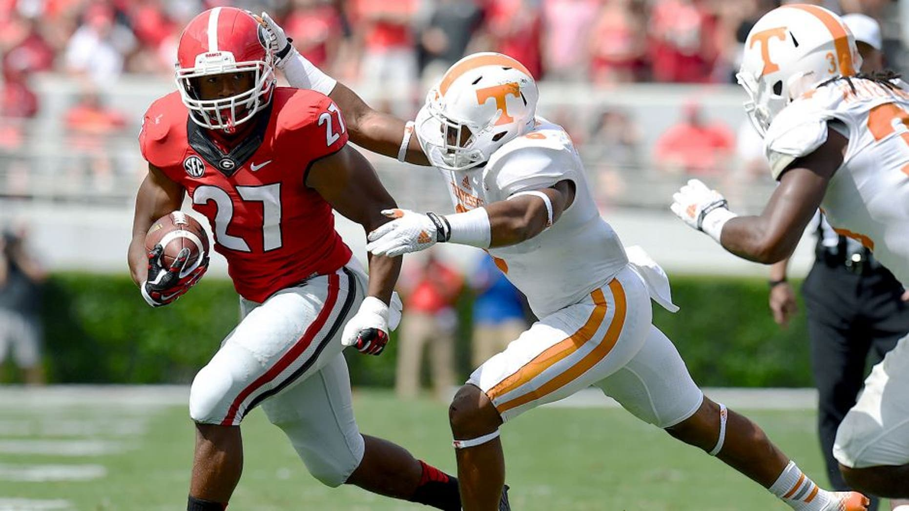 Sep 27, 2014; Athens, GA, USA; Georgia Bulldogs running back Nick Chubb (27) runs against Tennessee Volunteers defensive back Todd Kelly Jr. (6) during the first half at Sanford Stadium. Mandatory Credit: Dale Zanine-USA TODAY Sports