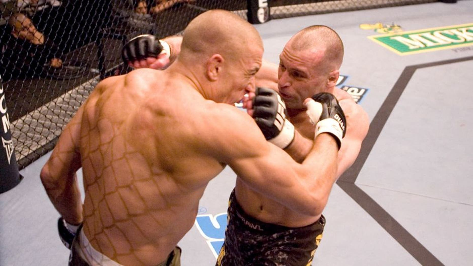 HOUSTON - APRIL 7: Matt Serra (brown/camo shorts) def. Georges St-Pierre (green shorts) - TKO - 3:25 round 1 during UFC 69 at Toyota Center on April 7, 2007 in Houston, Texas. (Photo by Josh Hedges/Zuffa LLC via Getty Images)