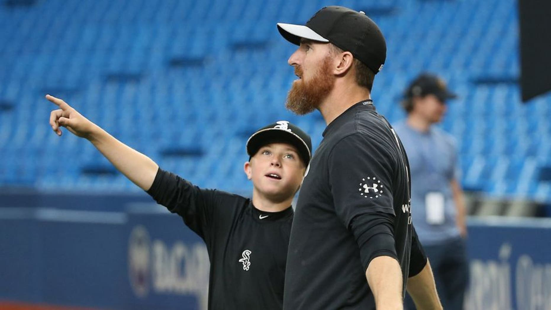 TORONTO, CANADA - MAY 25: Drake the son of Adam LaRoche #25 of the Chicago White Sox points to the roof as it opens during batting practice before the start of MLB game action against the Toronto Blue Jays on May 25, 2015 at Rogers Centre in Toronto, Ontario, Canada. (Photo by Tom Szczerbowski/Getty Images)