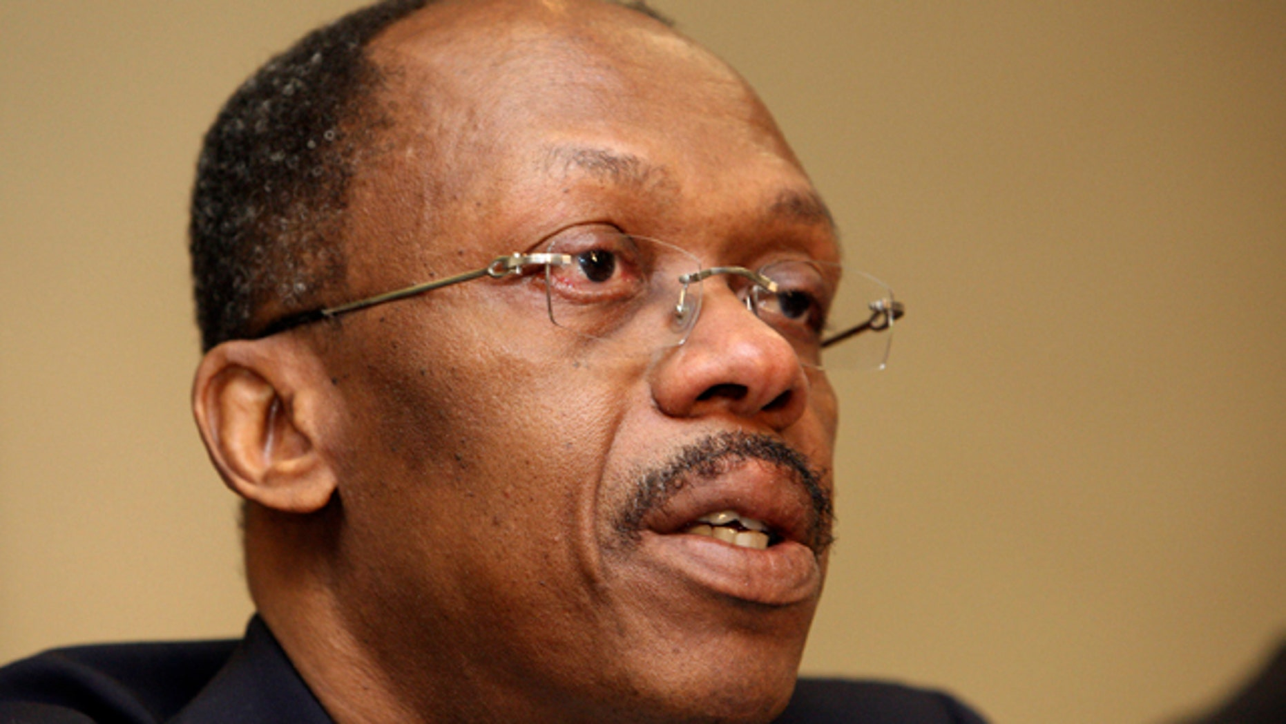 In this Jan. 15, 2010, file photo, Former Haitian President Jean-Bertrand Aristide speaks during a press conference in Johannesburg, South Africa.