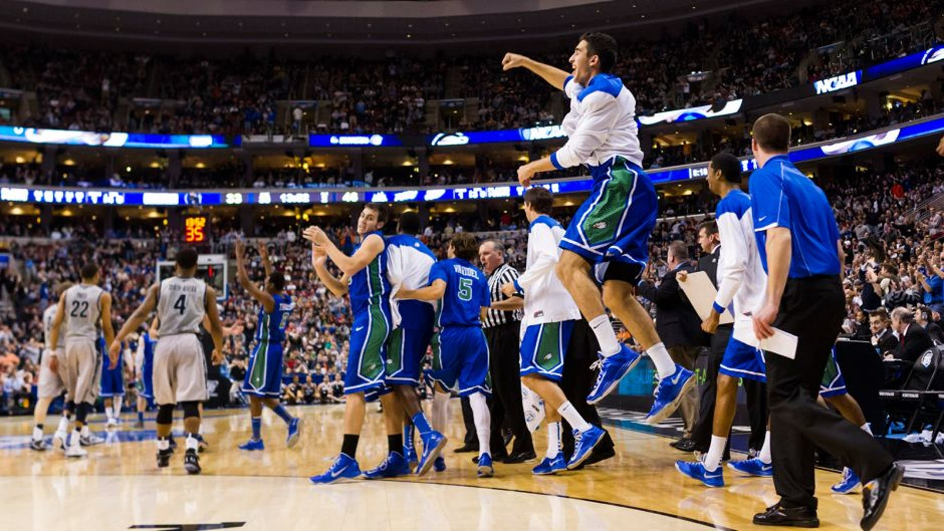 Mar 22, 2013; Philadelphia, PA, USA; Florida Gulf Coast Eagles players celebrate ;ate in the second half against the Georgetown Hoyas during the second round of the 2013 NCAA tournament at the Wells Fargo Center. Florida Gulf Coast defeated Georgetown 78-68. Mandatory Credit: Howard Smith-USA TODAY Sports
