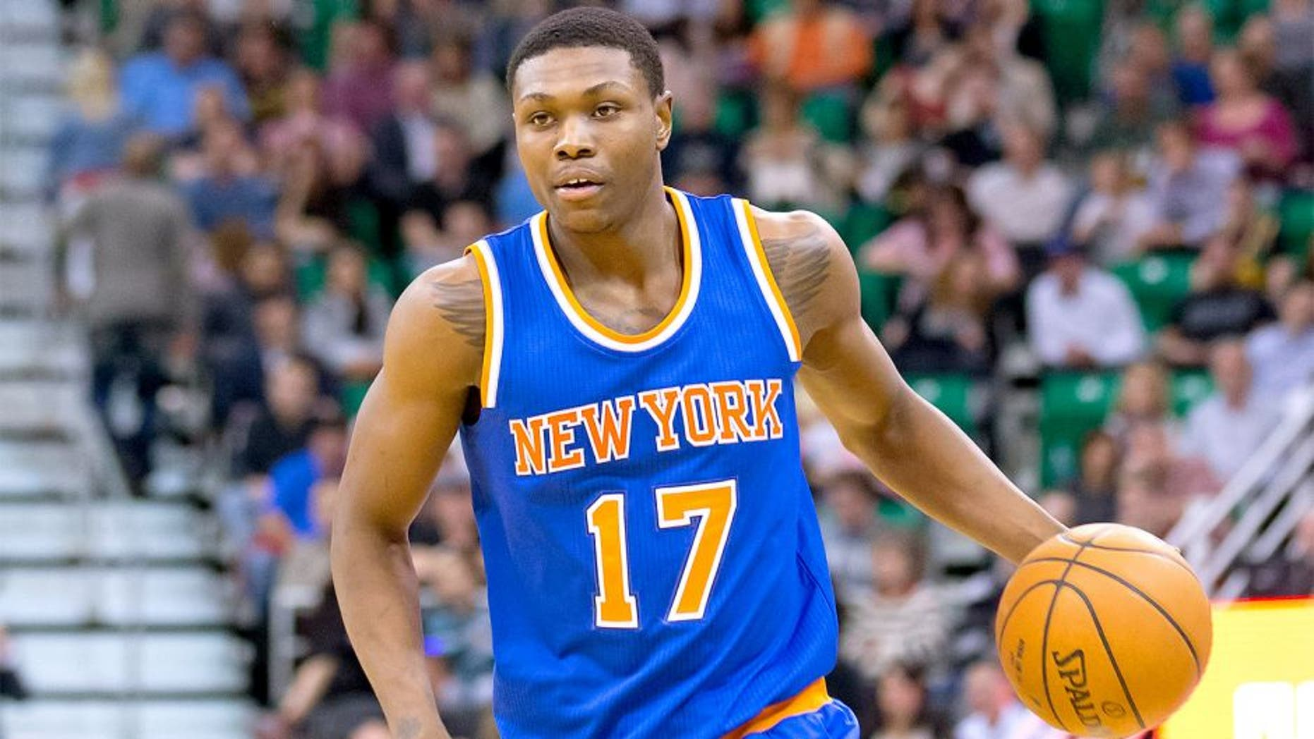 Mar 10, 2015; Salt Lake City, UT, USA; New York Knicks forward Cleanthony Early (17) dribbles the ball during the first half against the Utah Jazz at EnergySolutions Arena. The Jazz won 87-82. Mandatory Credit: Russ Isabella-USA TODAY Sports