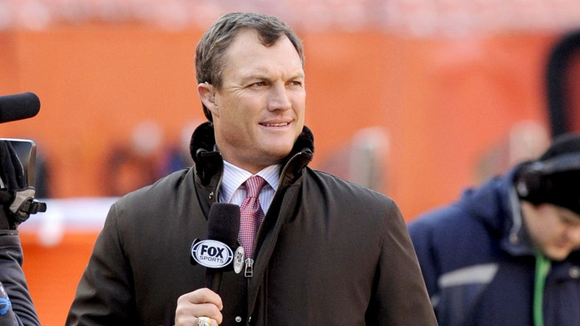 CLEVELAND, OH - DECEMBER 7, 2014: Fox Sports analyst John Lynch watches warm ups on the field prior to a game between the Indianapolis Colts and the Cleveland Browns on December 7, 2014 at FirstEnergy Stadium in Cleveland, Ohio. Indianapolis won 25-24. (Photo by Nick Cammett/Diamond Images/Getty Images)