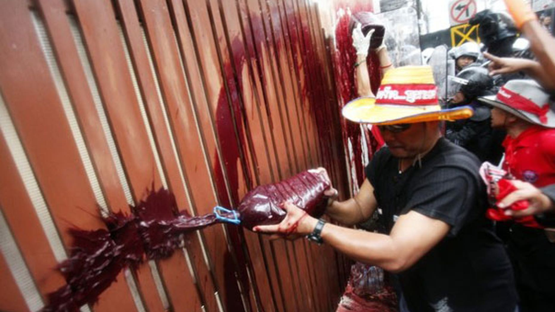 March 17: Anti-government protesters splash human blood on the gates of Prime Minister Abhisit Vejjajiva's home in a shocking attempt to force new elections.