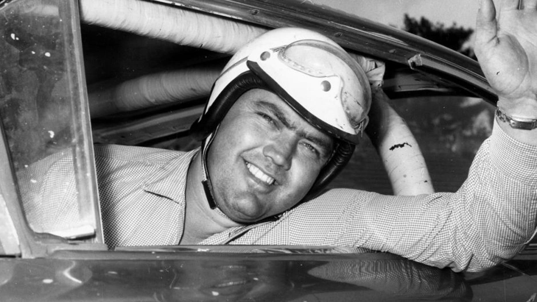 1959: Junior Johnson looks out his car window before a race. Johnson racked up 50 wins during his NASCAR Cup Series driving career, being named one of the organization's 50 Greatest Drivers. (Photo by: RacingOne/Getty Images) *** Local Caption *** Junior Johnson