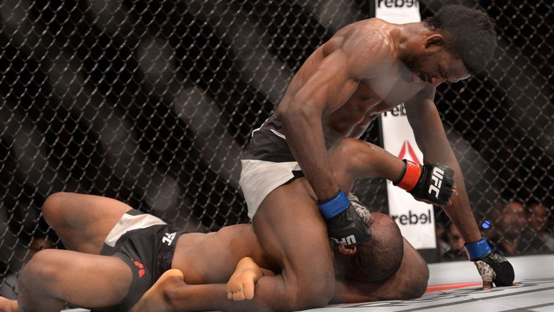 BRISBANE, AUSTRALIA - MARCH 20: Neil Magny dominates against Hector Lombard during their UFC Welterweight Bout at UFC Brisbane on March 20, 2016 in Brisbane, Australia. (Photo by Bradley Kanaris/Getty Images)