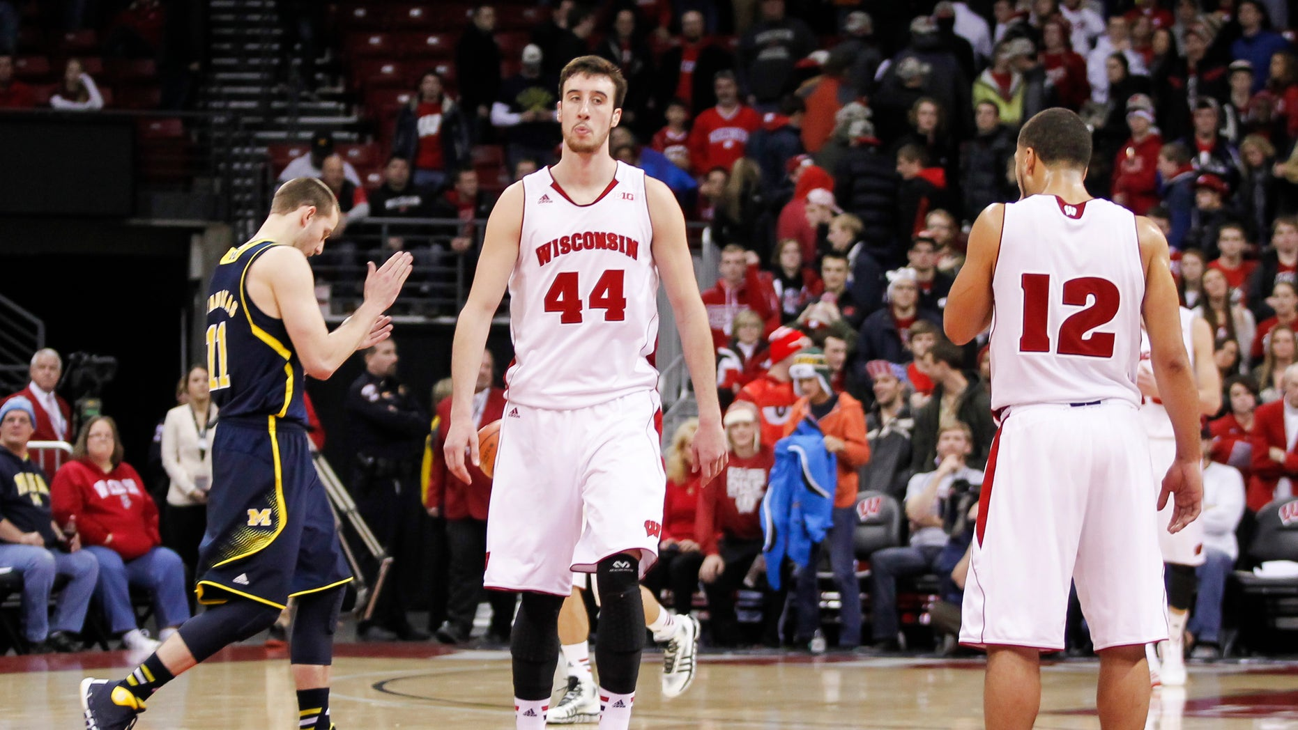 Wisconsin's Frank Kaminsky (44) and Traevon Jackson (12) walk off the court after the team's 77-70 loss to Michigan in an NCAA college basketball game Saturday, Jan. 18, 2014, in Madison, Wis.  (AP Photo/Andy Manis)