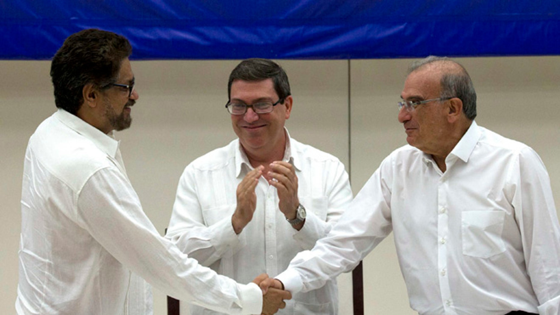 Humberto de La Calle, Ivan Marquez and Cuban Foreign Minister Bruno Rodriguez after signing an agreement in Havana, Cuba.