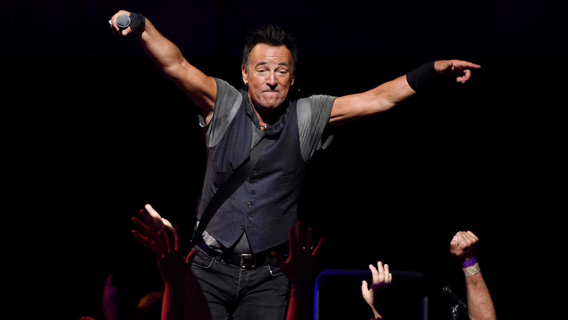Bruce Springsteen interacts with the crowd during his concert with the E Street Band at the Los Angeles Sports Arena on Tuesday, March 15, 2016, in Los Angeles.
