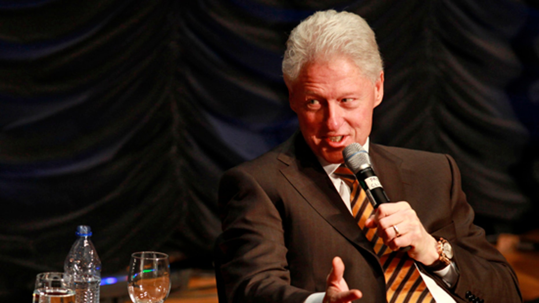 """Former President Bill Clinton answers questions after giving the keynote address at the """"25 Years of Dot Com Policy Impact Forum,"""" in Washington, on Tuesday, March 16, 2010. (AP)"""
