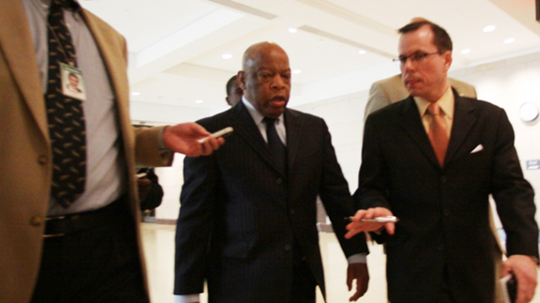 Rep. John Lewis, D-Ga., is questioned by reporters about an incident involving Tea Party demonstrators as he leaves a speech by President Obama to House Democrats on Saturday, March 20, 2010. (AP)