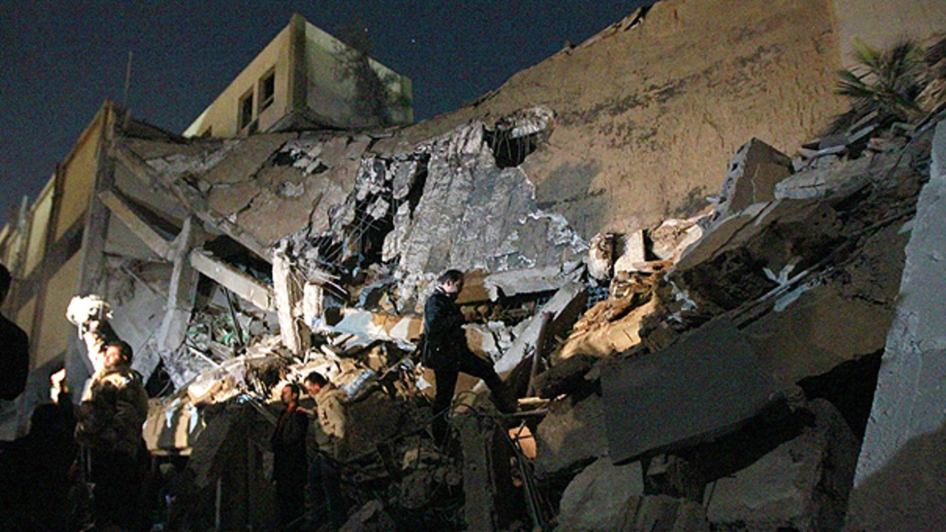 March 21: Libyan soldiers survey the damage to an administrative building hit by a missile late Sunday in the heart of Muammar al-Qaddafi's Bab Al Azizia compound in Tripoli.