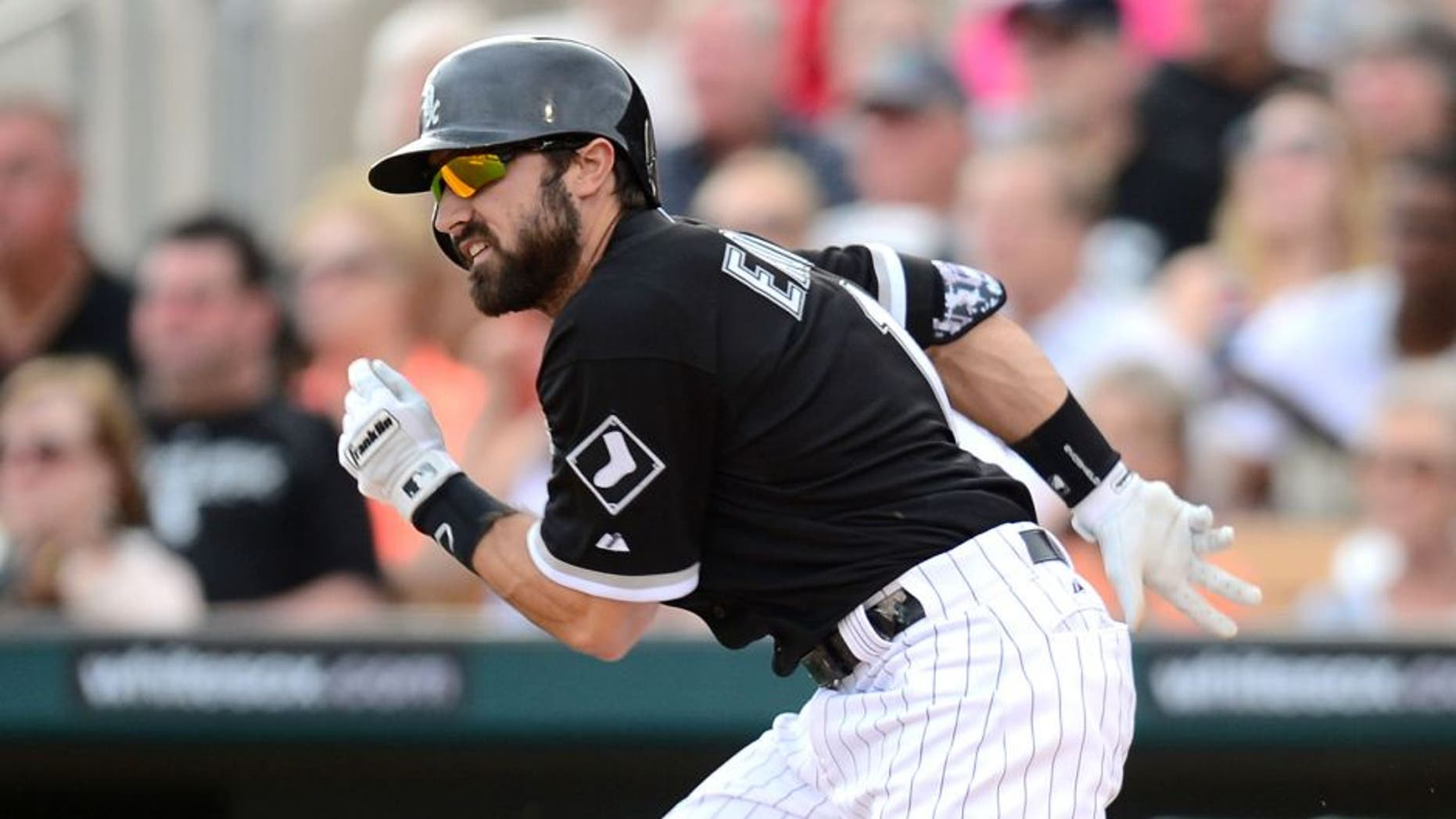 Mar 12, 2015; Phoenix, AZ, USA; Chicago White Sox center fielder Adam Eaton (1) runs to first base against the San Francisco Giants at Camelback Ranch. Mandatory Credit: Joe Camporeale-USA TODAY Sports