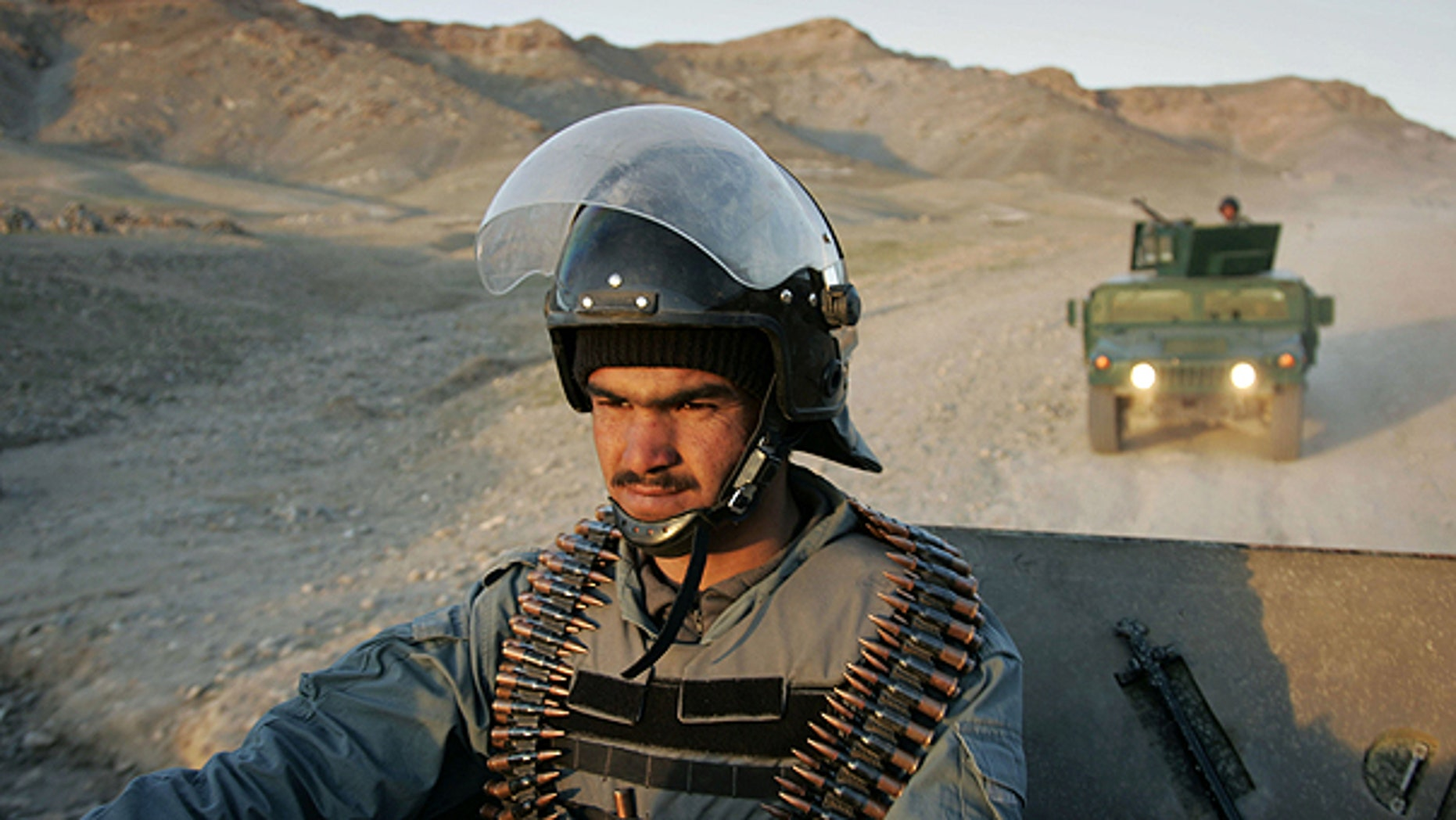 March 19: An Afghan policeman controls the area during a patrol in Guzara district, Herat province east of Kabul, Afghanistan.