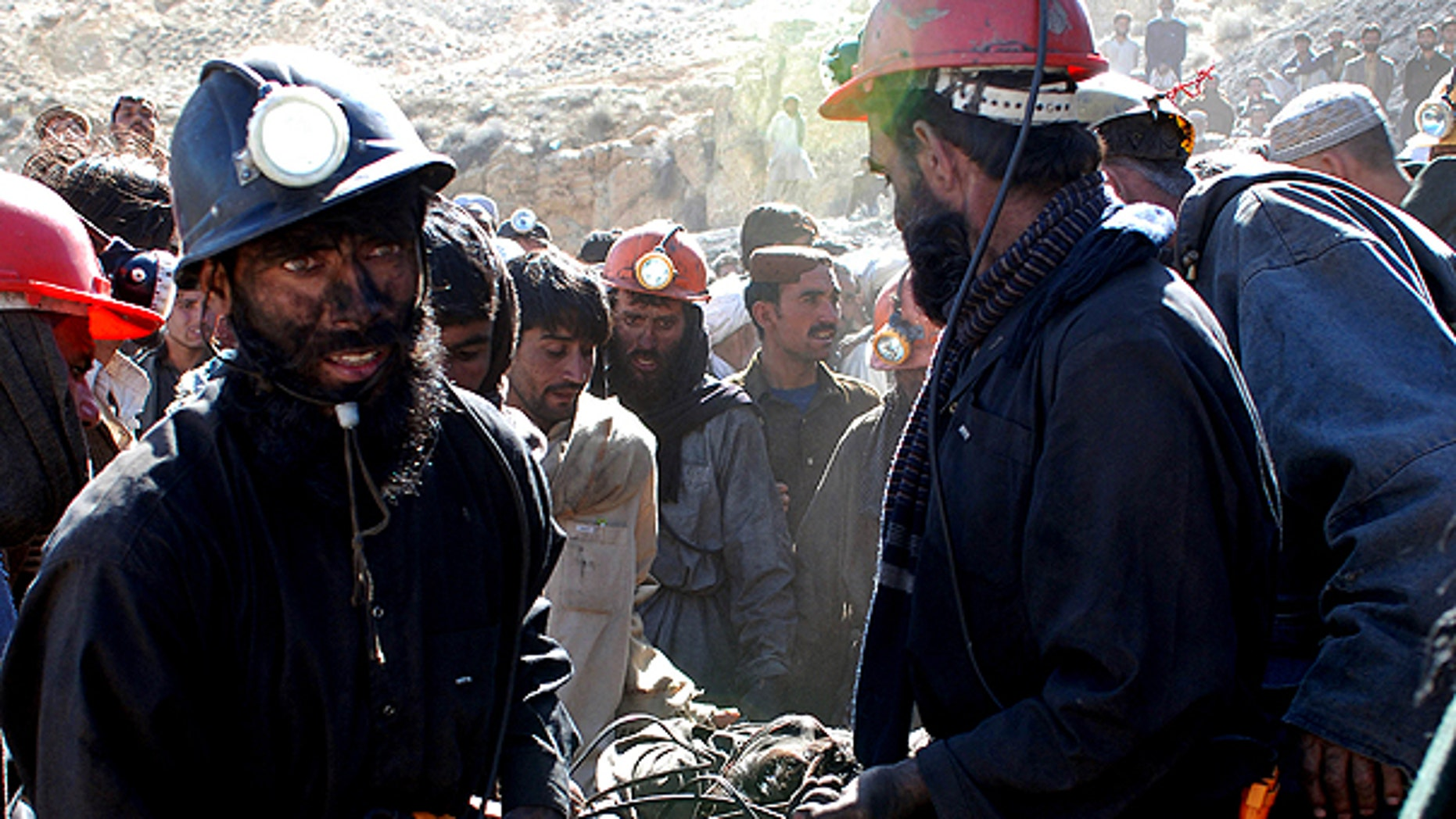 March 21: Pakistani mine workers carry a dead body of their colleague at a coal mine in Sorange near Quetta, Pakistan.