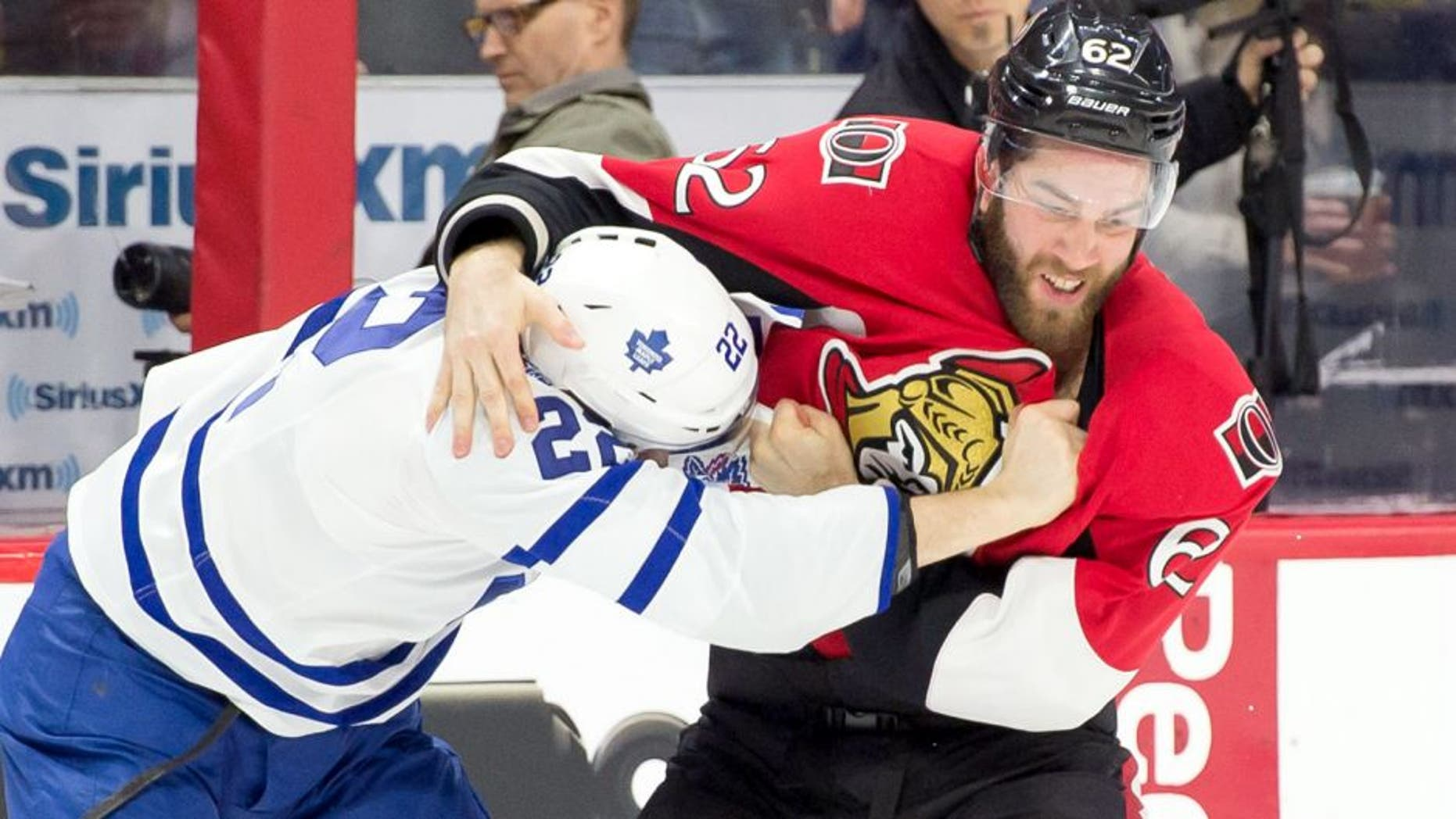 Mar 21, 2015; Ottawa, Ontario, CAN; Toronto Maple Leafs center Zach Sill (22) fights with Ottawa Senators defenseman Eric Gryba (62) in the first period at the Canadian Tire Centre. Mandatory Credit: Marc DesRosiers-USA TODAY Sports