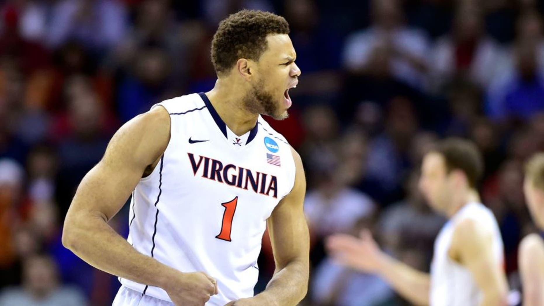 Mar 20, 2015; Charlotte, NC, USA; Virginia Cavaliers guard Justin Anderson (1) reacts to a play during the second half against the Belmont Bruins in the second round of the 2015 NCAA Tournament at Time Warner Cable Arena. Mandatory Credit: Bob Donnan-USA TODAY Sports