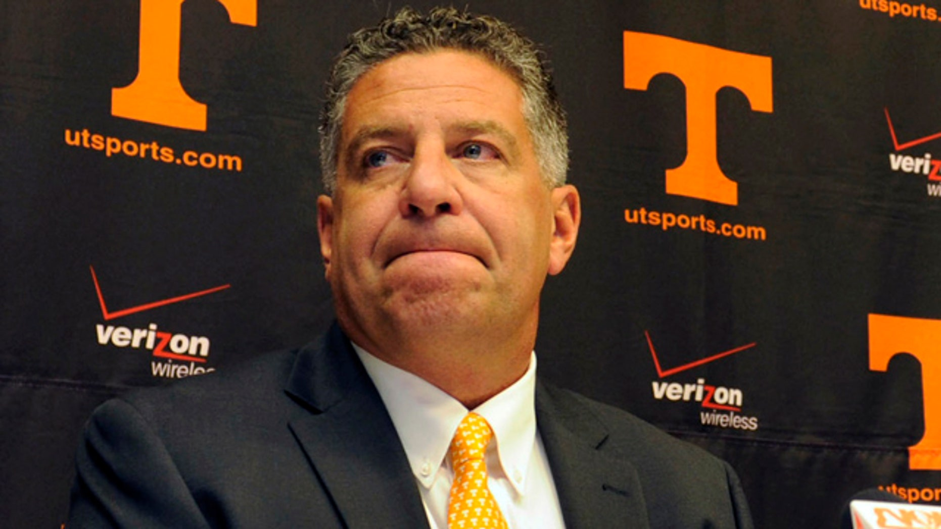 This Sept. 10, 2010, file photo shows University of Tennessee men's basketball coach Bruce Pearl grimacing during a news conference, where  Pearl expressed remorse for giving misleading information to the NCAA during an investigation into the school's basketball program, in Knoxville, Tenn.