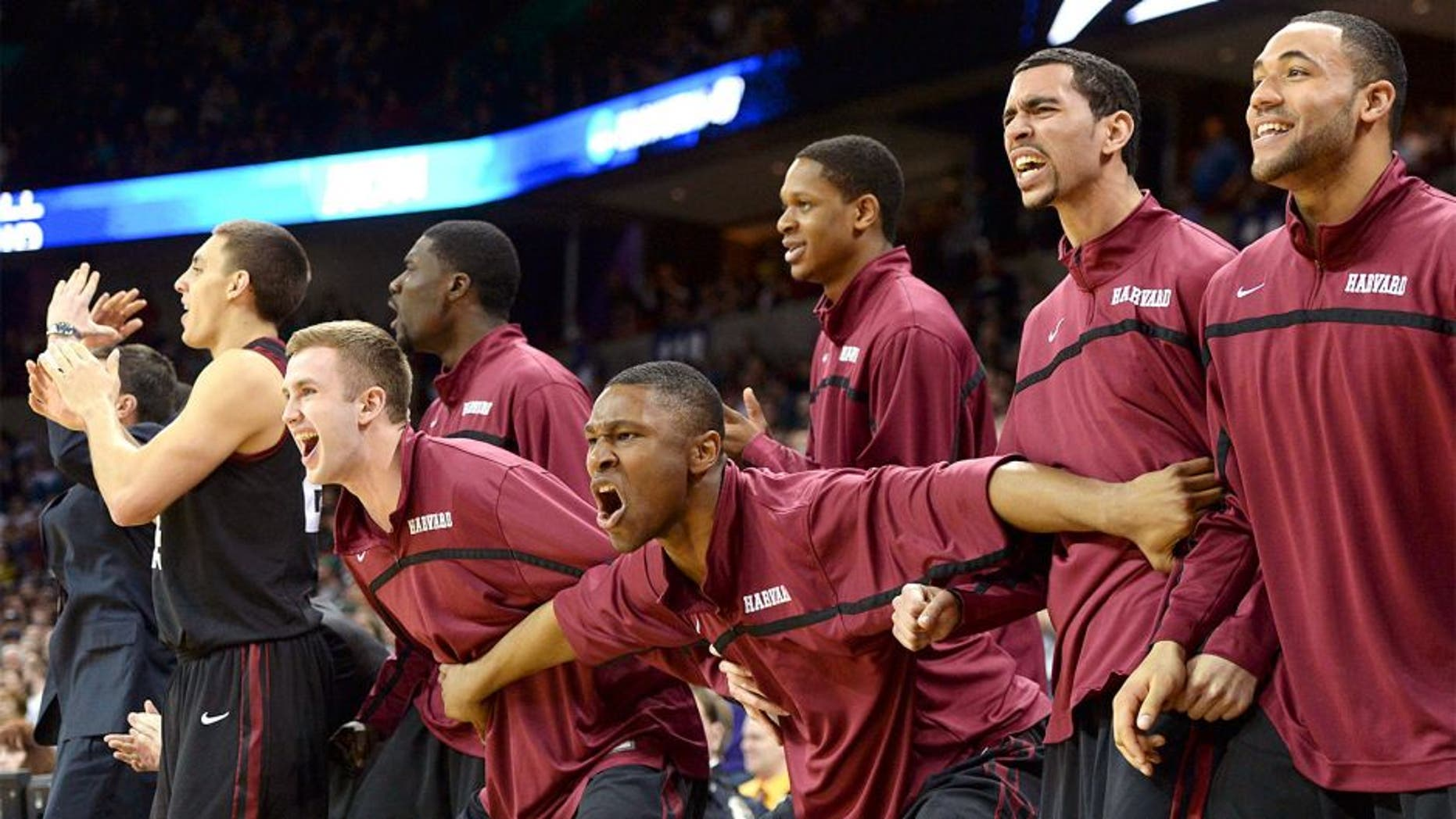 Mar 22, 2014; Spokane, WA, USA; Harvard Crimson players celebrate against the Michigan State Spartans in the second half of a men's college basketball game during the third round of the 2014 NCAA Tournament at Veterans Memorial Arena. Mandatory Credit: Kirby Lee-USA TODAY Sports