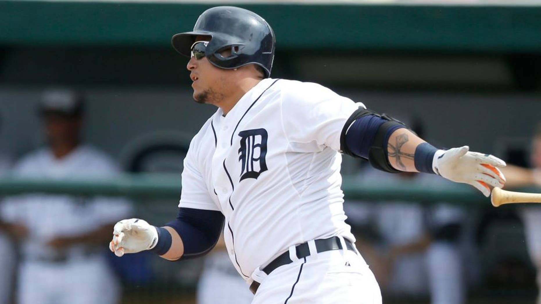 Detroit Tigers' Miguel Cabrera singles to left field during the sixth inning of a spring training exhibition baseball game against the Washington Nationals in Lakeland, Fla., Sunday, March 22, 2015. (AP Photo/Carlos Osorio)