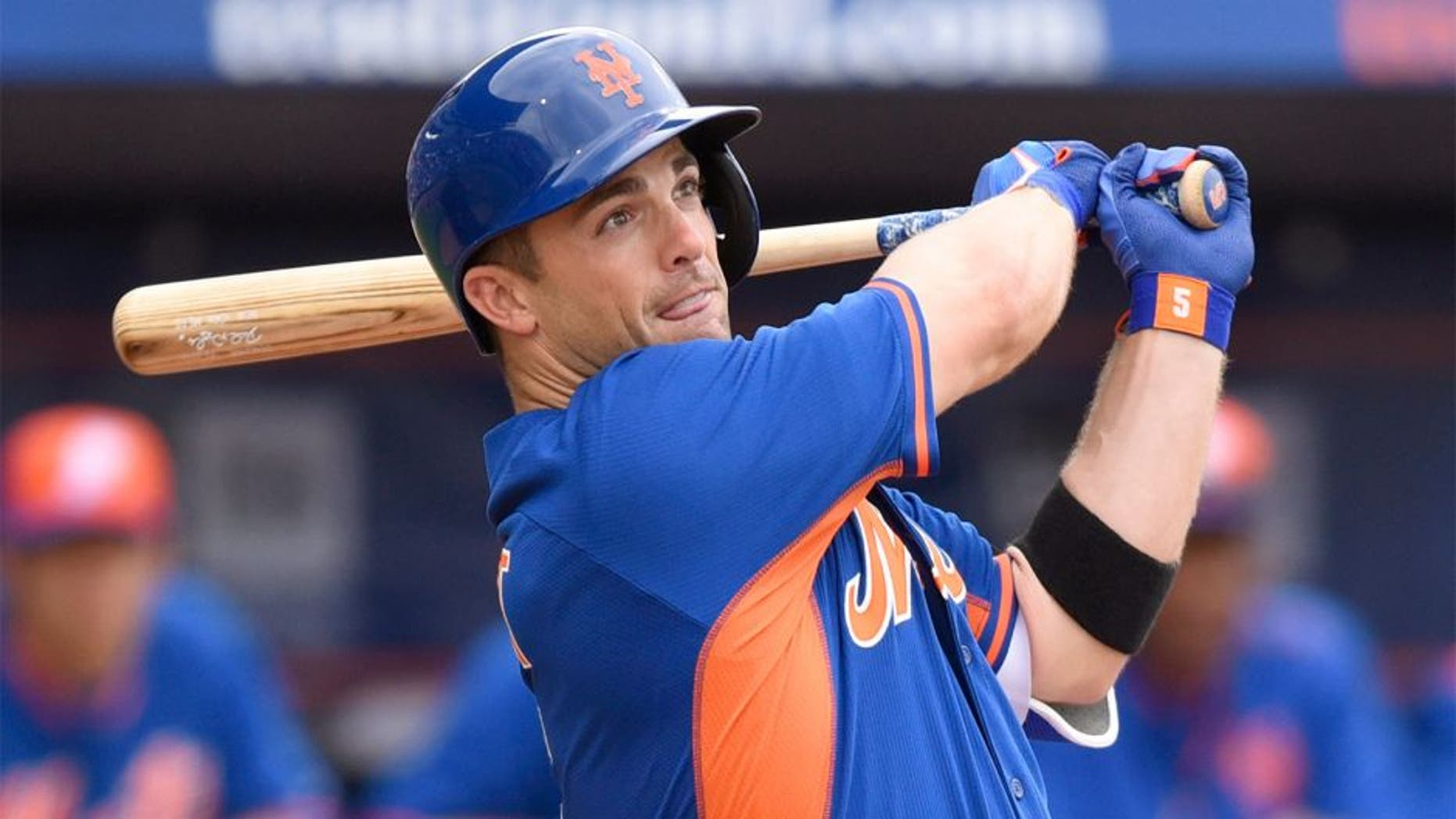 Mar 7, 2015; Port St. Lucie, FL, USA; New York Mets third baseman David Wright (5) hits a double against the Atlanta Braves during the spring training baseball game at Tradition Field. Mandatory Credit: Brad Barr-USA TODAY Sports