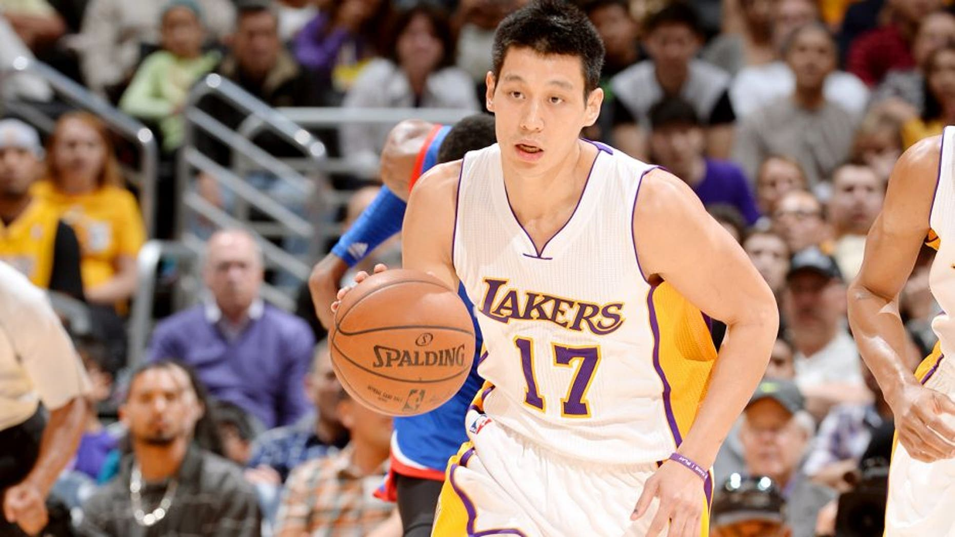 LOS ANGELES, CA - MARCH 22: Jeremy Lin #17 of the Los Angeles Lakers brings the ball up court against the Philadelphia 76ers on March 22, 2015 at Staples Center in Los Angeles, California. NOTE TO USER: User expressly acknowledges and agrees that, by downloading and or using this Photograph, user is consenting to the terms and conditions of the Getty Images License Agreement. Mandatory Copyright Notice: Copyright 2015 NBAE (Photo by Andrew D. Bernstein/NBAE via Getty Images)