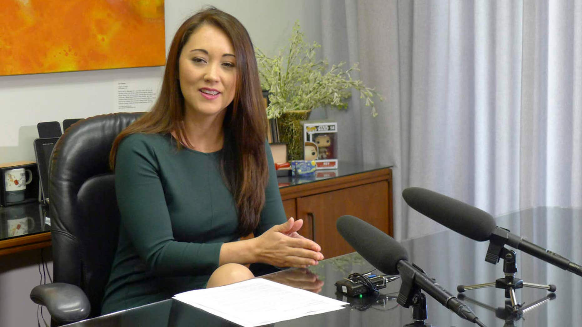 Hawaii Rep. Beth Fukumoto talks to reporters about why she's leaving the Republican Party on Wednesday, March 22, 2017, in Honolulu.