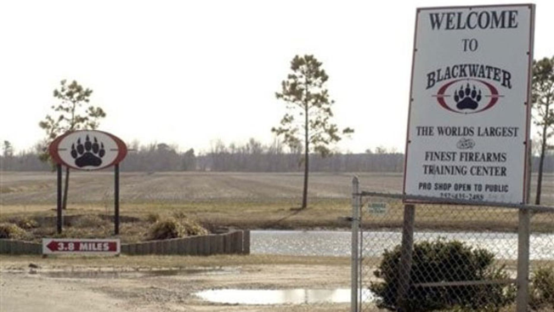 In this Feb. 20, 2004 file photo, signs welcome visitors to the private North Carolina-based security company Blackwater USA's headquarters near Moyock, N.C. (AP).