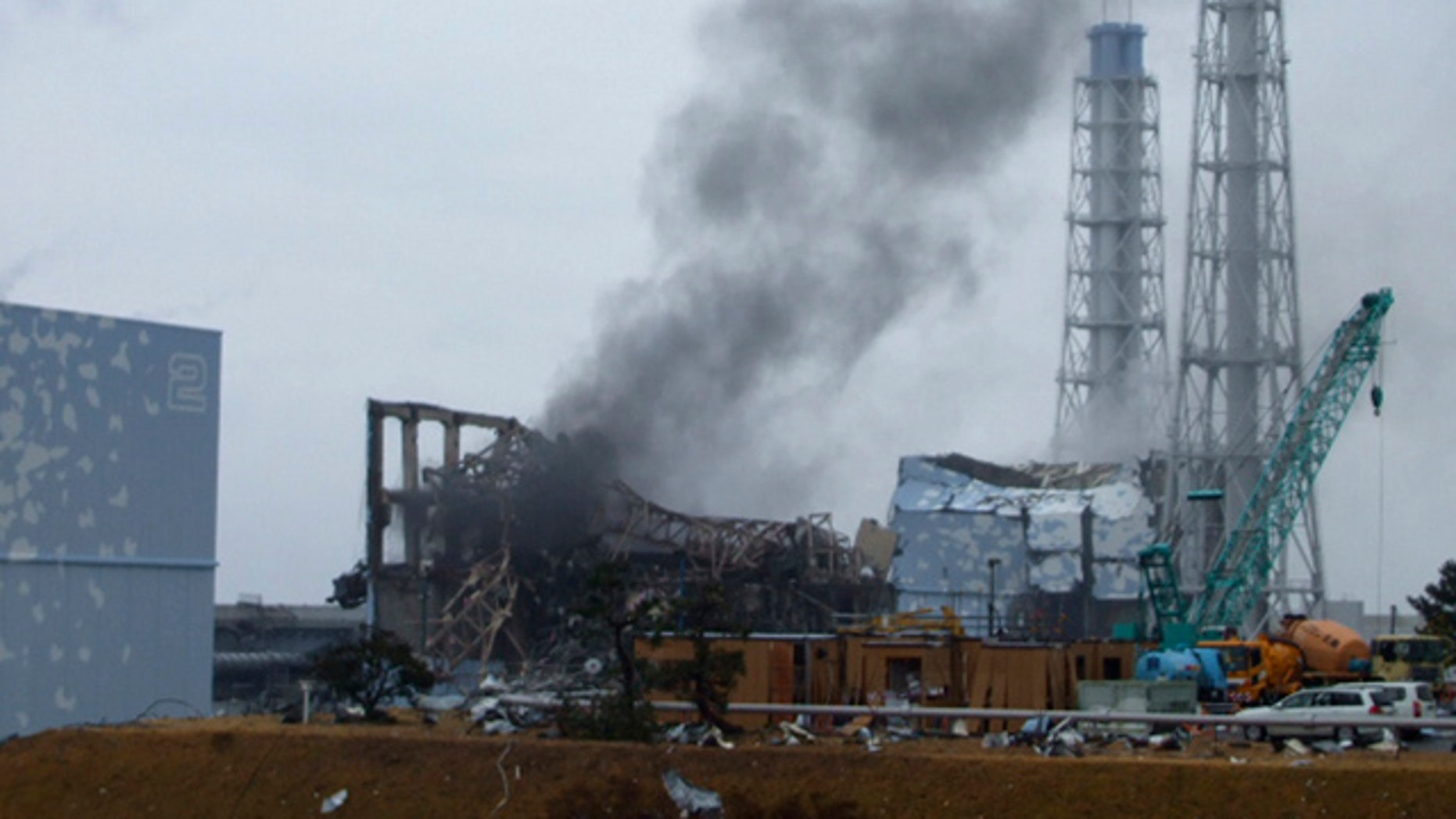 March 21: In this photo released by Tokyo Electric Power Co. (TEPCO), gray smoke rises from Unit 3 of the tsunami-stricken Fukushima Dai-ichi nuclear power plant in Okumamachi, Fukushima Prefecture, Japan.