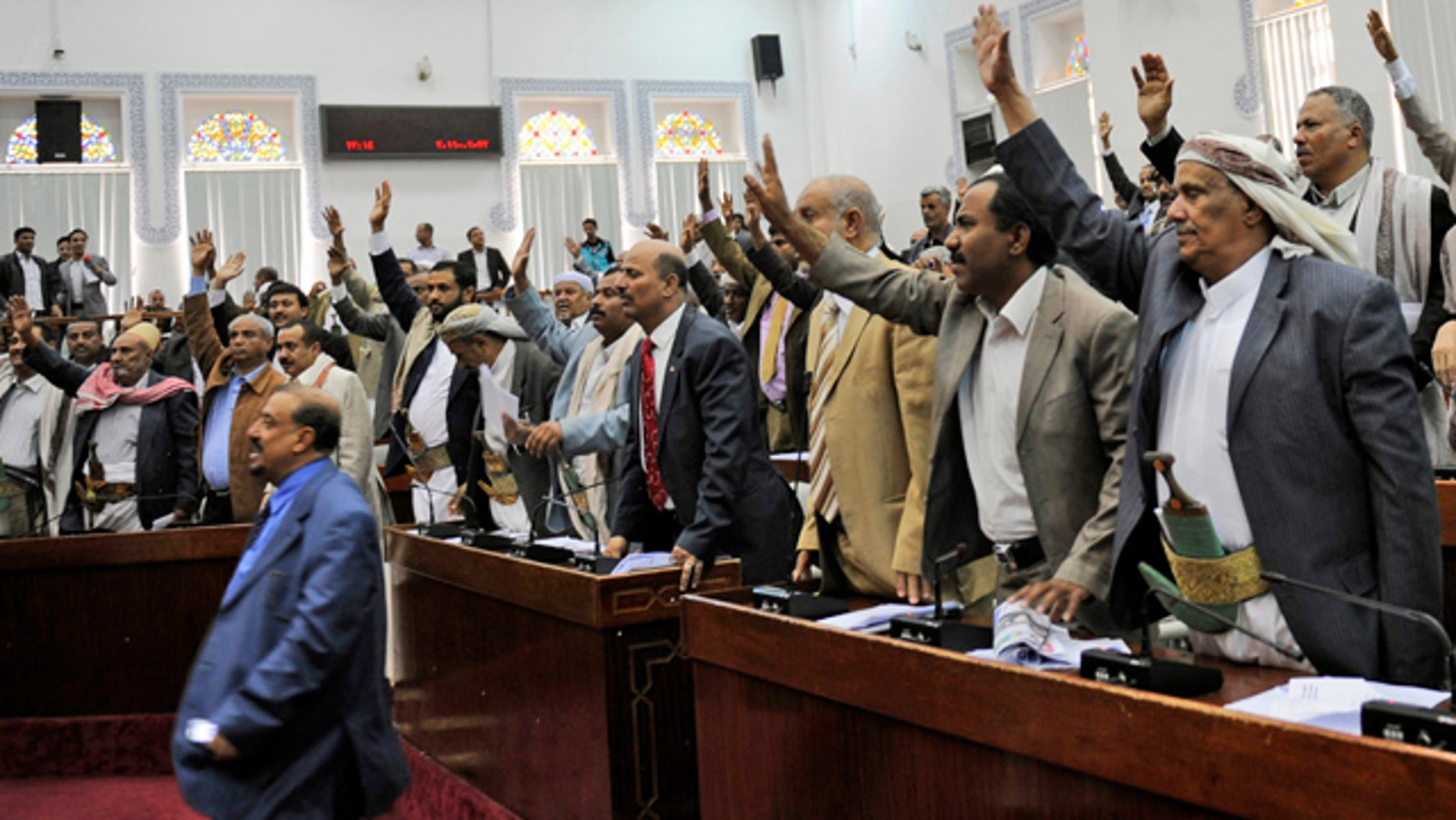 March 23: Members of the Yemeni parliament raise their hands as they vote in favor of the state of emergency during a session in Sanaa, Yemen.