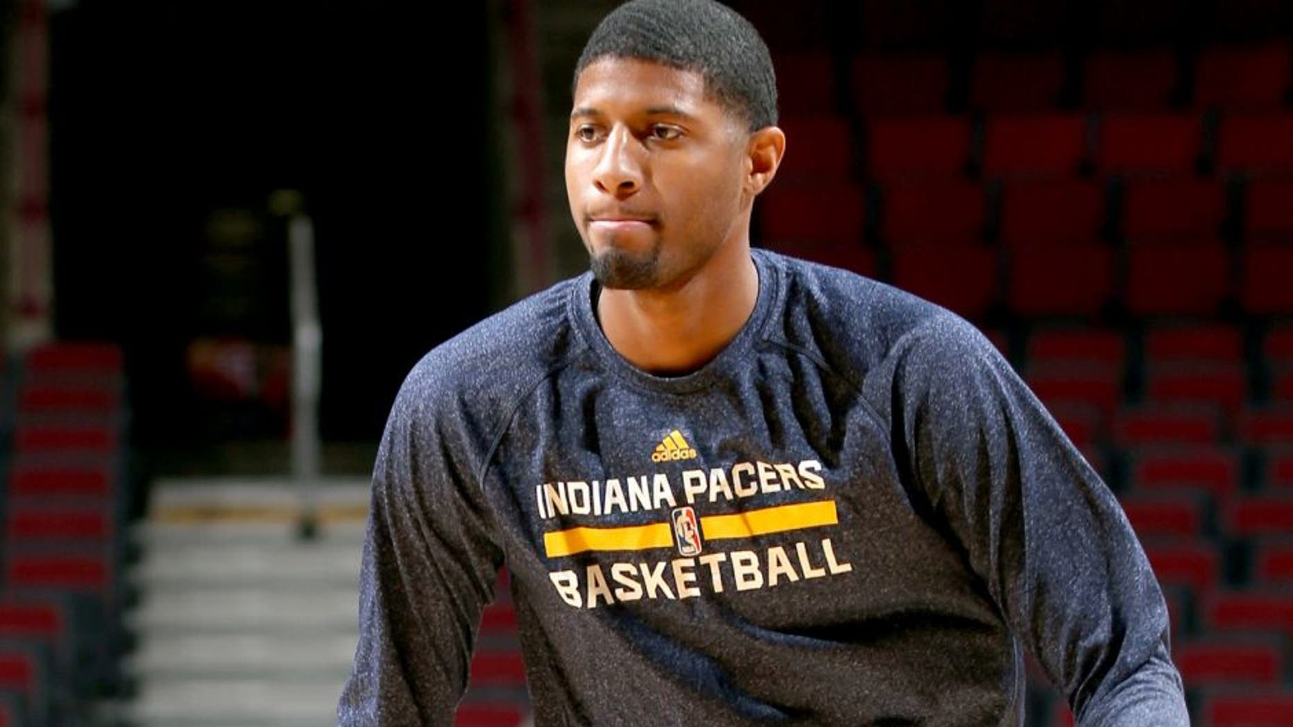 CHICAGO, IL - MARCH 18: Paul George #13 of the Indiana Pacers warms up before a game against the Chicago Bulls on March 18, 2015 at the United Center in Chicago, Illinois. NOTE TO USER: User expressly acknowledges and agrees that, by downloading and or using this Photograph, user is consenting to the terms and conditions of the Getty Images License Agreement. Mandatory Copyright Notice: Copyright 2015 NBAE (Photo by Joe Murphy/NBAE via Getty Images)