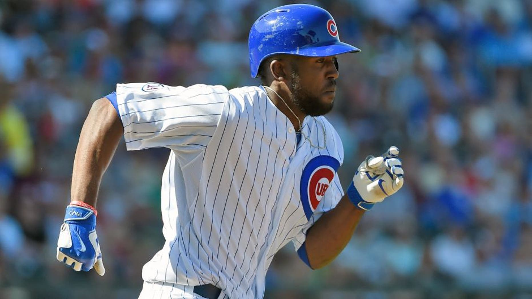 MESA, AZ - MARCH 09: Dexter Fowler #24 of the Chicago Cubs runs to first base after hitting a single against the San Diego Padres on March 9, 2015 in Mesa, Arizona. (Photo by Lisa Blumenfeld/Getty Images)