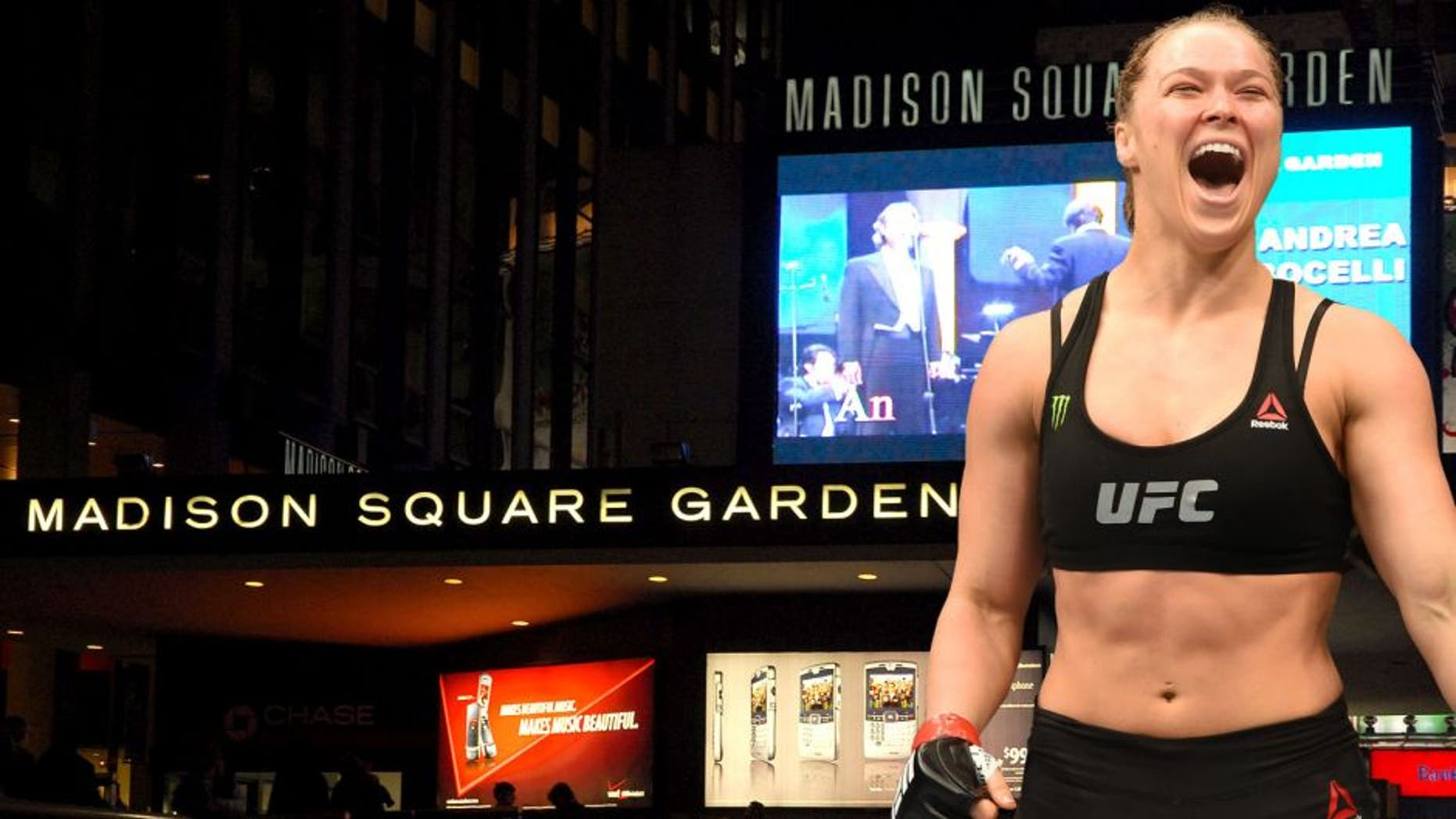 NEW YORK - NOVEMBER 30: The exterior of Madison Square Garden is seen prior to Andrea Bocelli's concert on November 30, 2006 in New York City. (Photo by Rob Loud/Getty Images), LOS ANGELES, CA - FEBRUARY 28: Ronda Rousey celebrates her victory over Cat Zingano in their UFC women's bantamweight championship bout during the UFC 184 event at Staples Center on February 28, 2015 in Los Angeles, California. (Photo by Harry How/Getty Images)