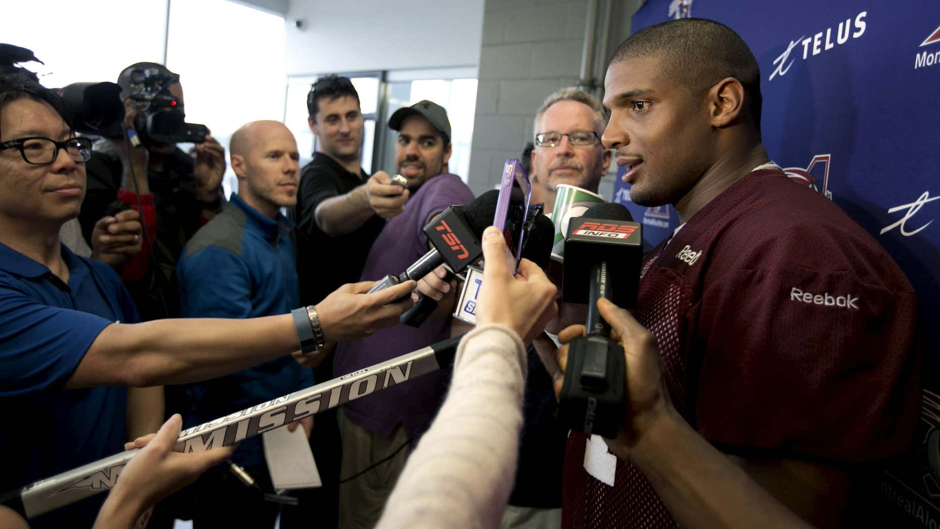 May 27, 2015: Michael Sam, newly signed defensive end for the Montreal Alouettes CFL football team talks to the media following his first day of rookie training camp in Sherbrooke, Quebec .