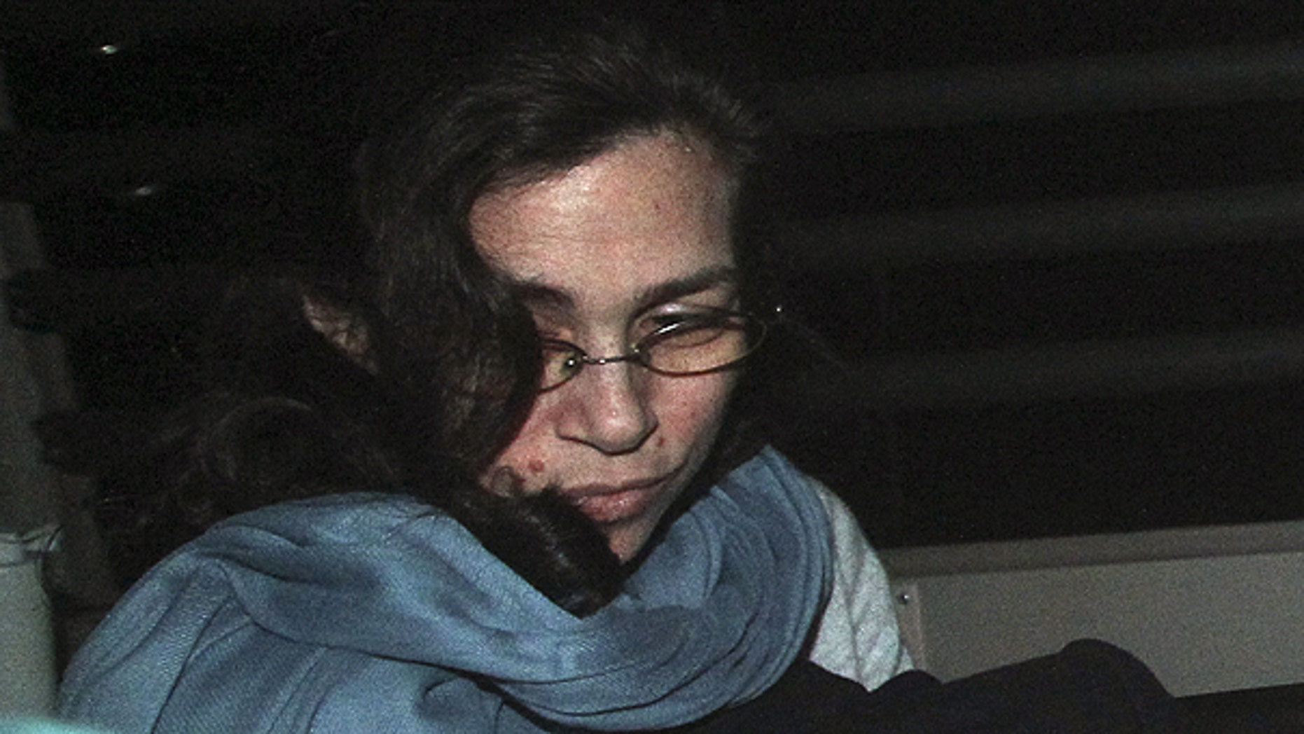 March 24: Nancy Kissel, an American woman accused of killing her husband, leaves the High Court by a prison van in Hong Kong.
