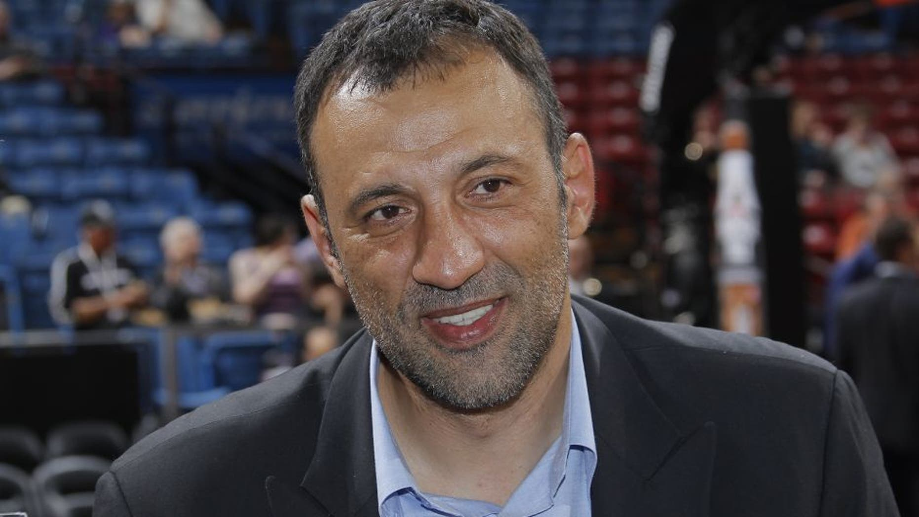SACRAMENTO, CA - MARCH 21: Former Sacramento Kings Vlade Divac talks with the local media before the Sacramento Kings take on the San Antonio Spurs at Sleep Train Arena on March 21, 2014 in Sacramento, California. NOTE TO USER: User expressly acknowledges and agrees that, by downloading and or using this photograph, User is consenting to the terms and conditions of the Getty Images Agreement. Mandatory Copyright Notice: Copyright 2014 NBAE (Photo by Rocky Widner/NBAE via Getty Images)