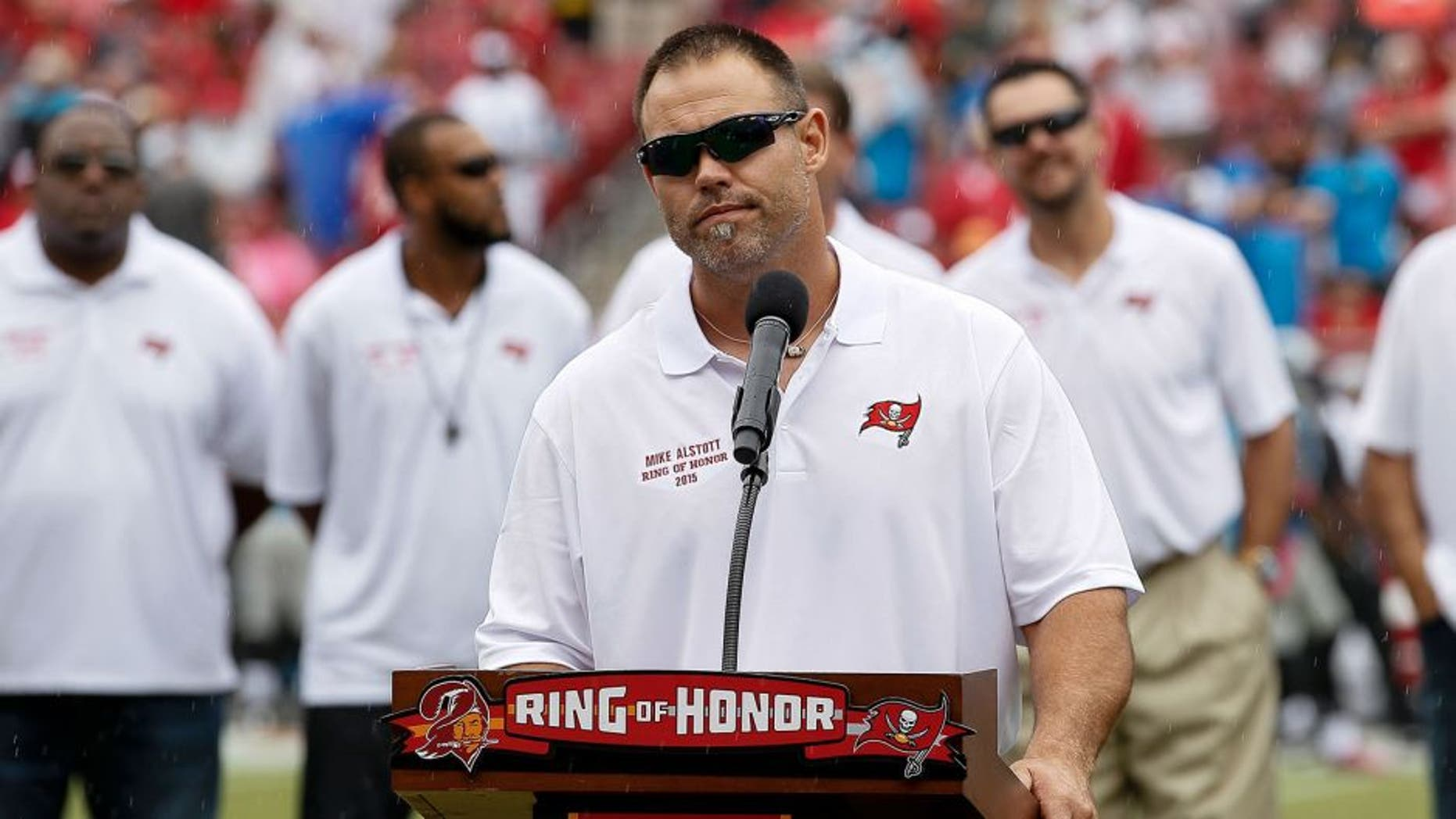 TAMPA, FL - OCTOBER 4: Former Runningback Mike Alstott of the Tampa Bay Buccaneers adresses the fans as he is being honored by being placed in the Ring of Honor during halftime against the Carolina Panthers at Raymond James Stadium on October 4, 2015 in Tampa, Florida. Alstott played his entire 12 year career with the Buccaneers from 1996 to 2007. Panthers defeated the Buccaneers 37 to 23. (Photo by Don Juan Moore/Getty Images)