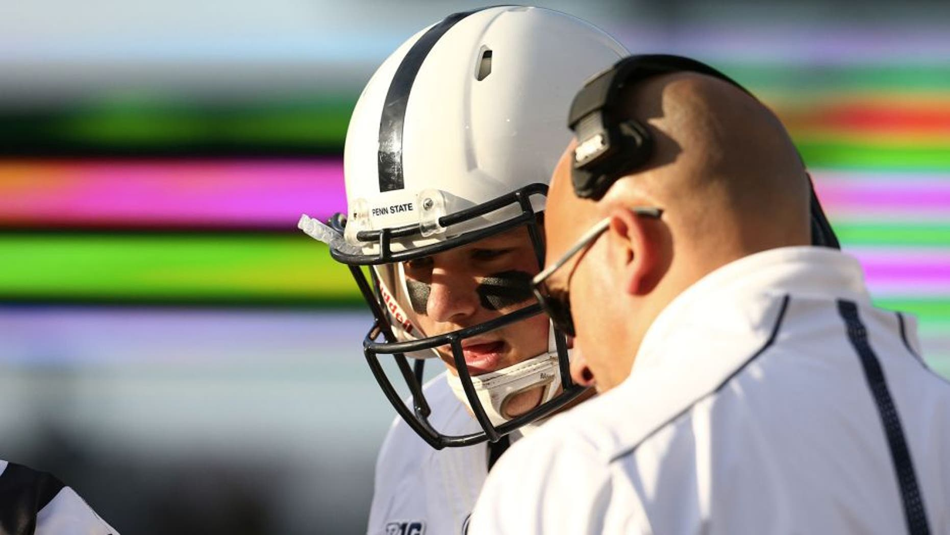 EAST LANSING, MI - NOVEMBER 28: Head coach James Franklin of the Penn State Nittany Lions talks with Christian Hackenberg #14 of the Penn State Nittany Lions on the sideline in the first quarter during the game against the Michigan State Spartans at Spartan Stadium on November 28, 2015 in East Lansing, Michigan. (Photo by Rey Del Rio/Getty Images)