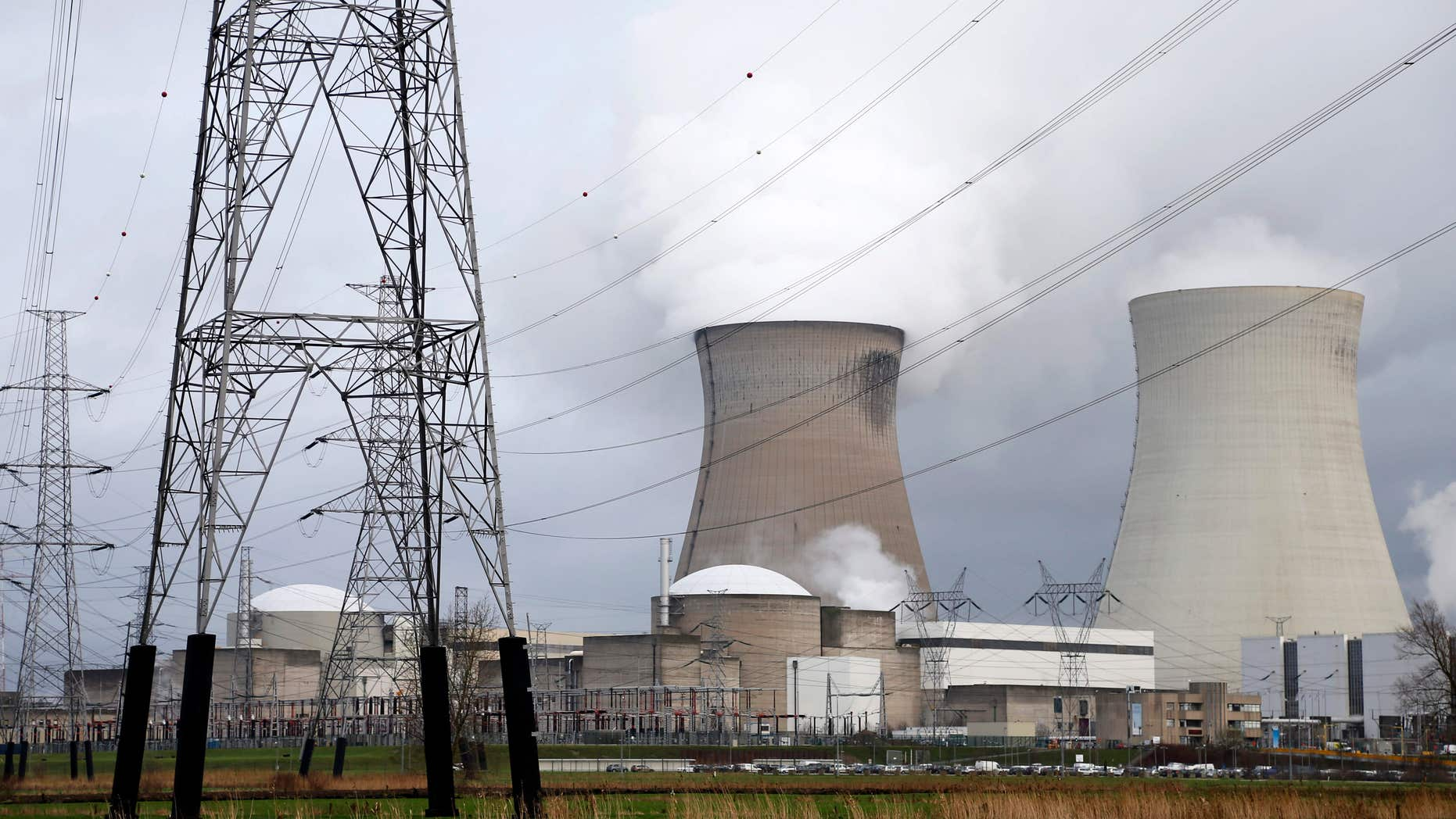 Jan. 4, 2016: High-voltage power lines are seen next to cooling towers of Doel's nuclear plant of Electrabel, the Belgian unit of French company Engie, former GDF Suez, in Doel near Antwerp, Belgium