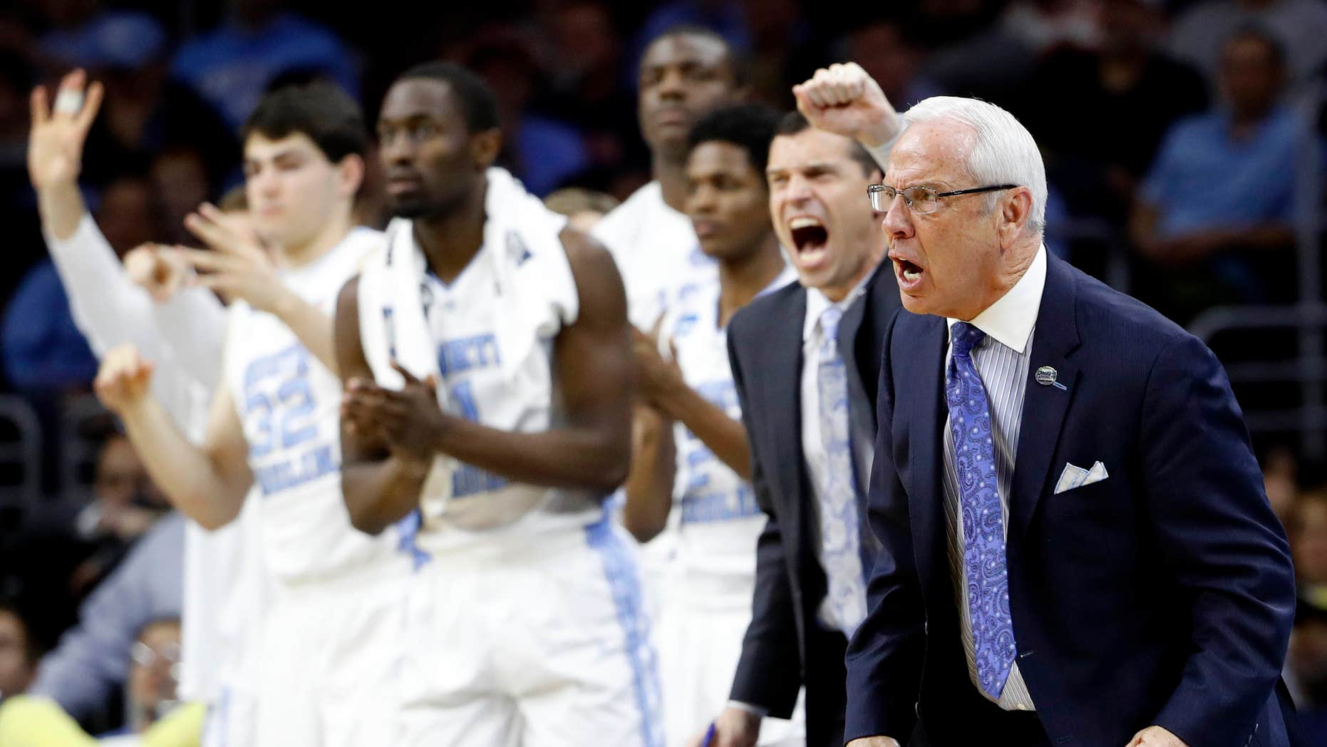 North Carolina coach Roy Williams and players react during the second half of the team's college basketball game against Indiana in the regional semifinals of the men's NCAA Tournament, early Saturday, March 26, 2016, in Philadelphia.